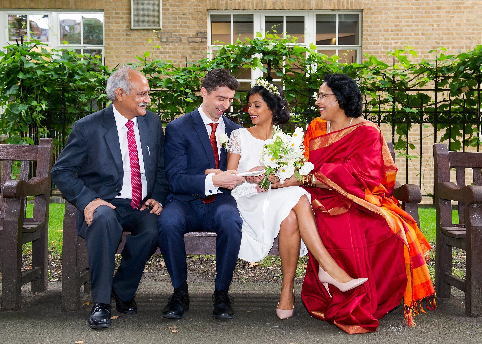 indian wedding photography at westminster register office here the parents gifting their daughter and new son-in-law