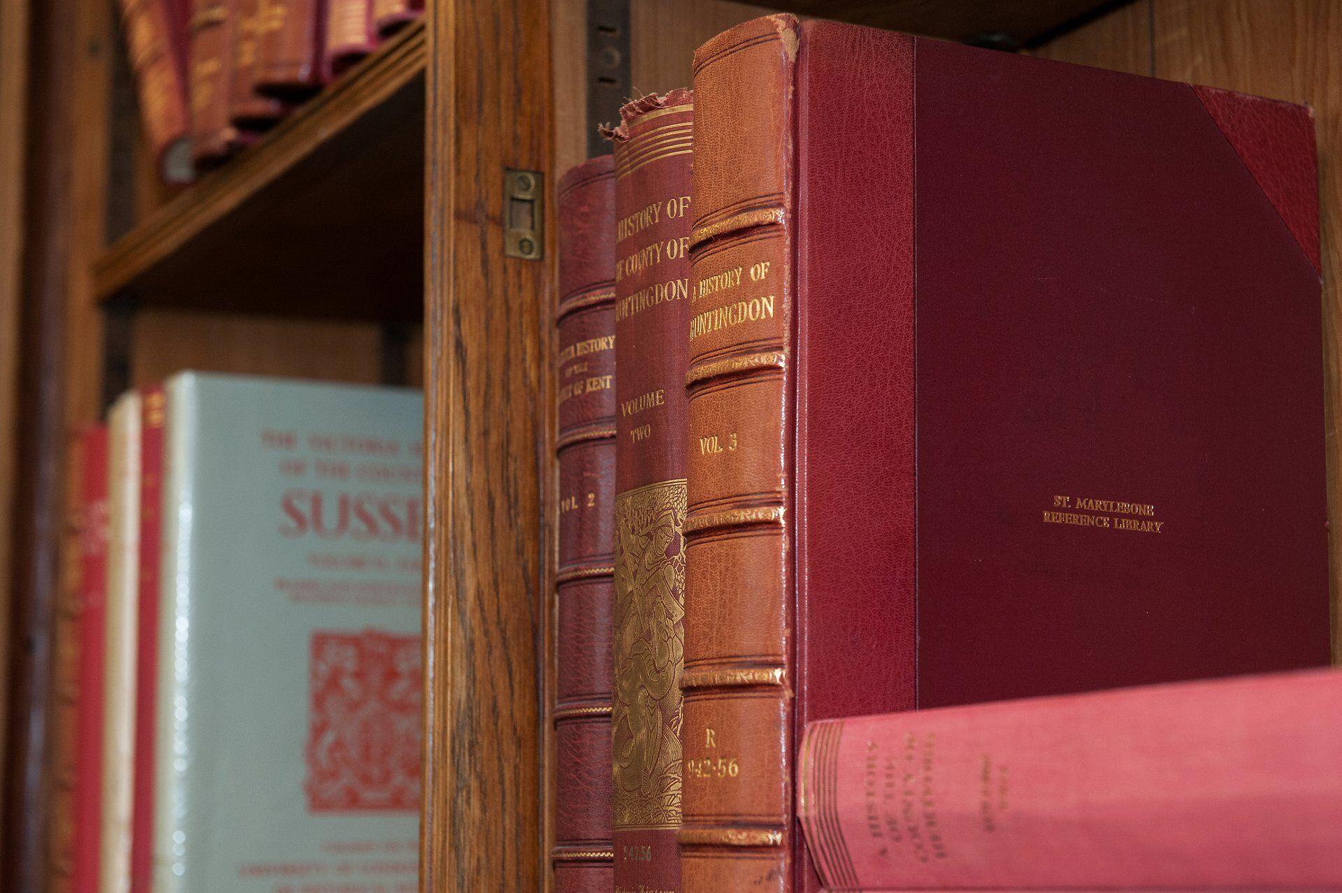 library books on bookshelves inside mayfair library in westminster