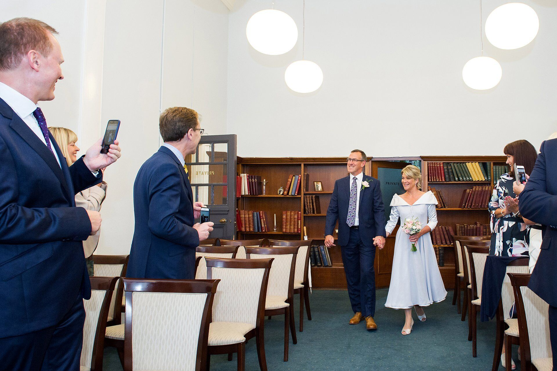 london register office wedding photographer a bride and groom walking into their civil wedding ceremony