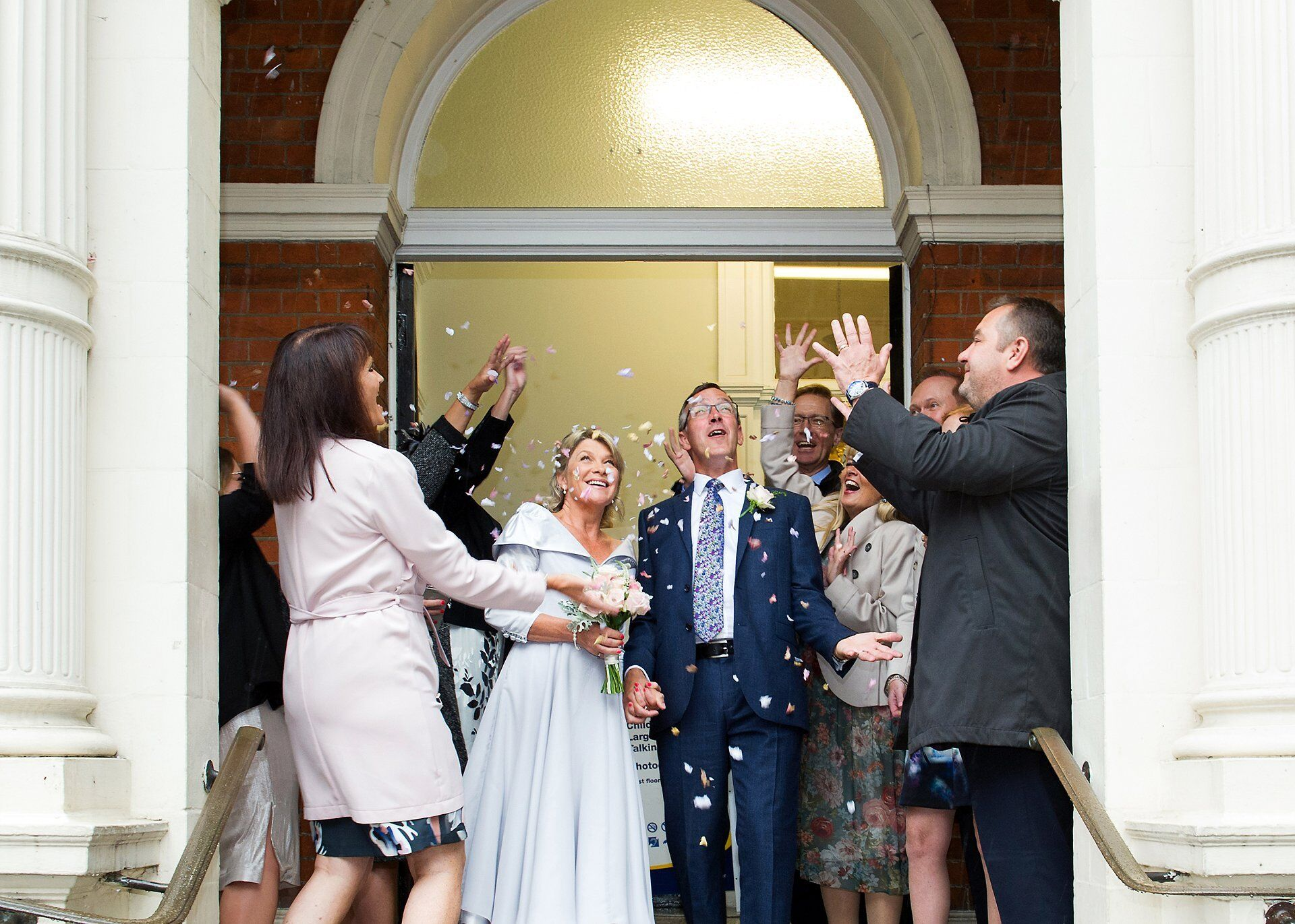 london register office wedding photography confetti shot outside mayfair library in westminster