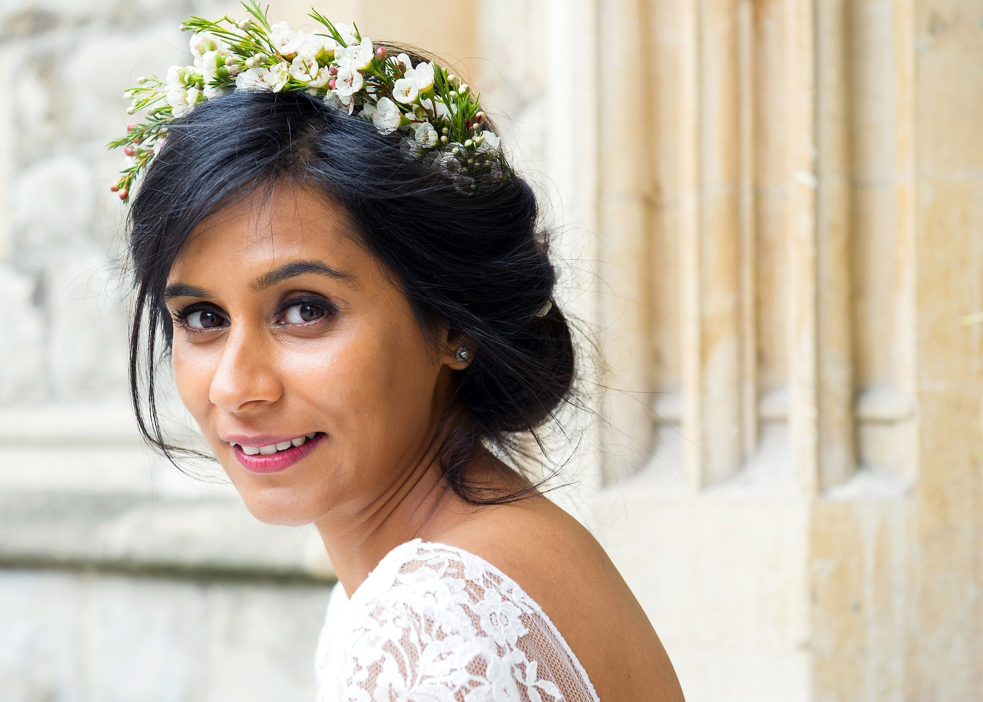london wedding photographer emma duggan showing a bride wearing a floral headpiece