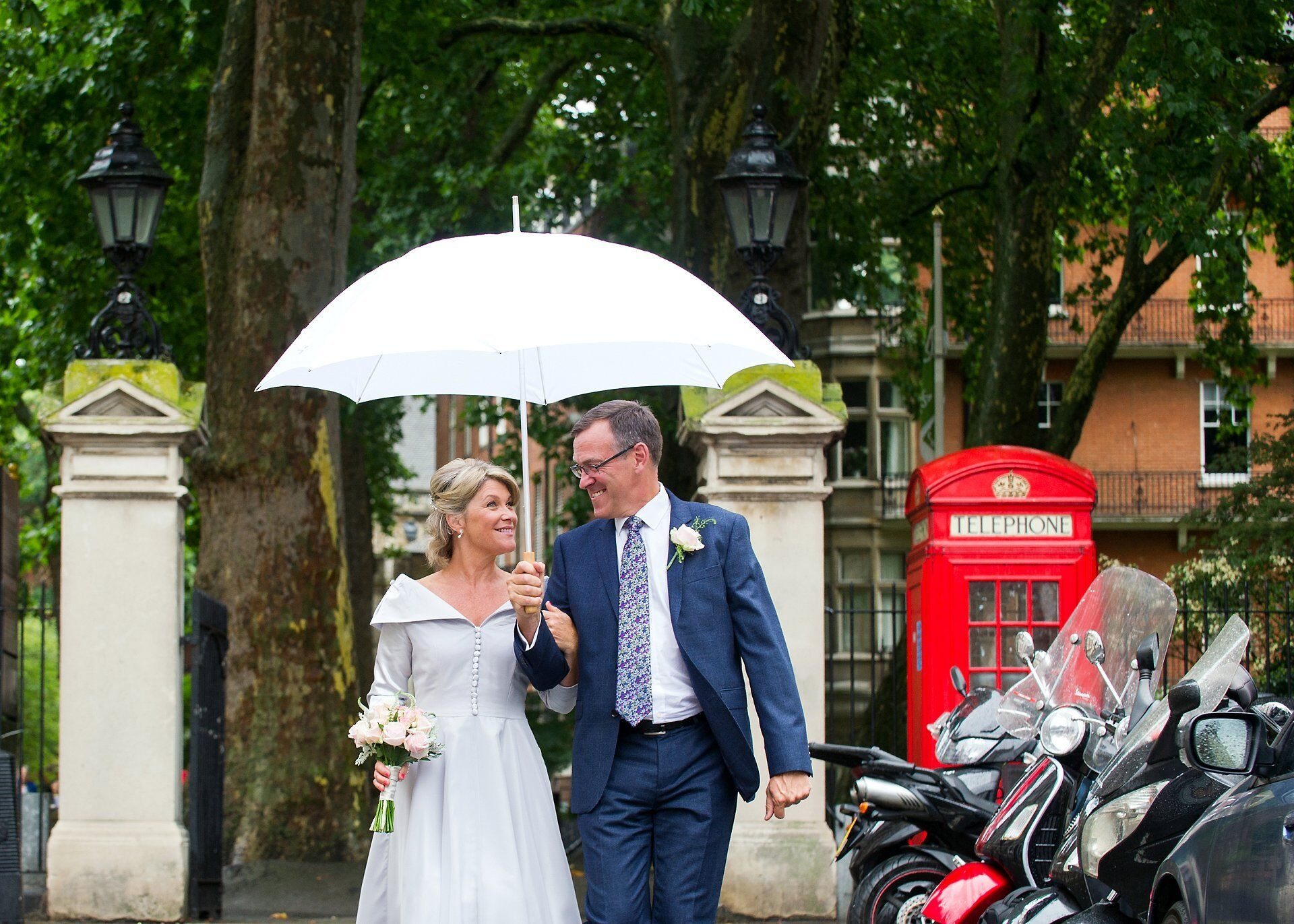 london wedding with white umbrella