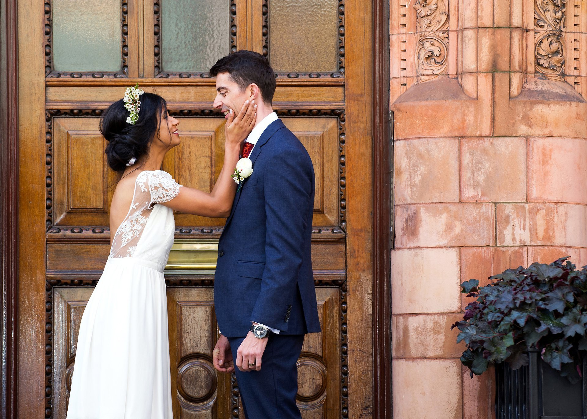 mount street wedding photography by emma duggan here showing a bride cupping her husband's face