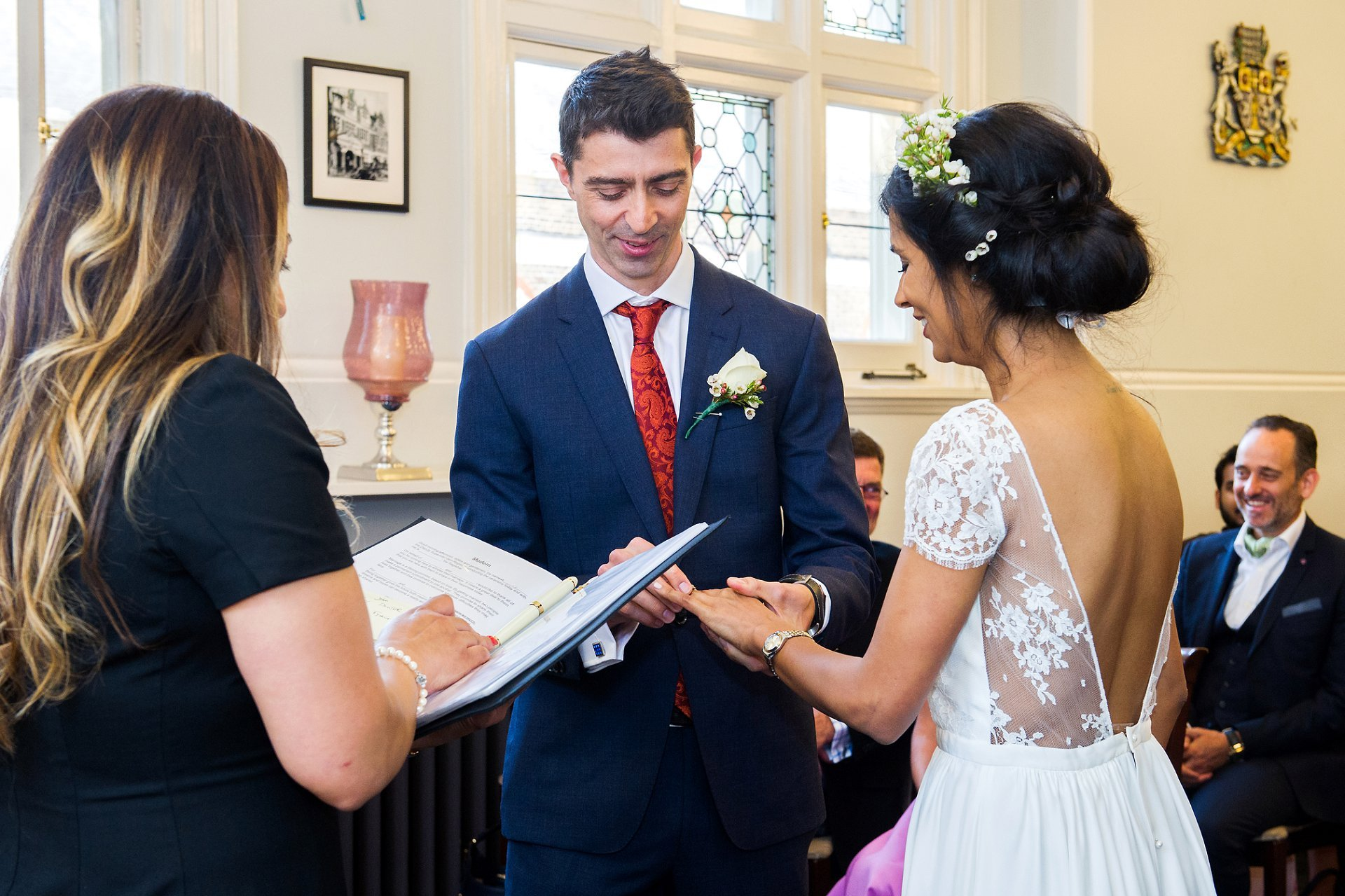 register office wedding photographer emma duggan during ring exchange at mayfair library