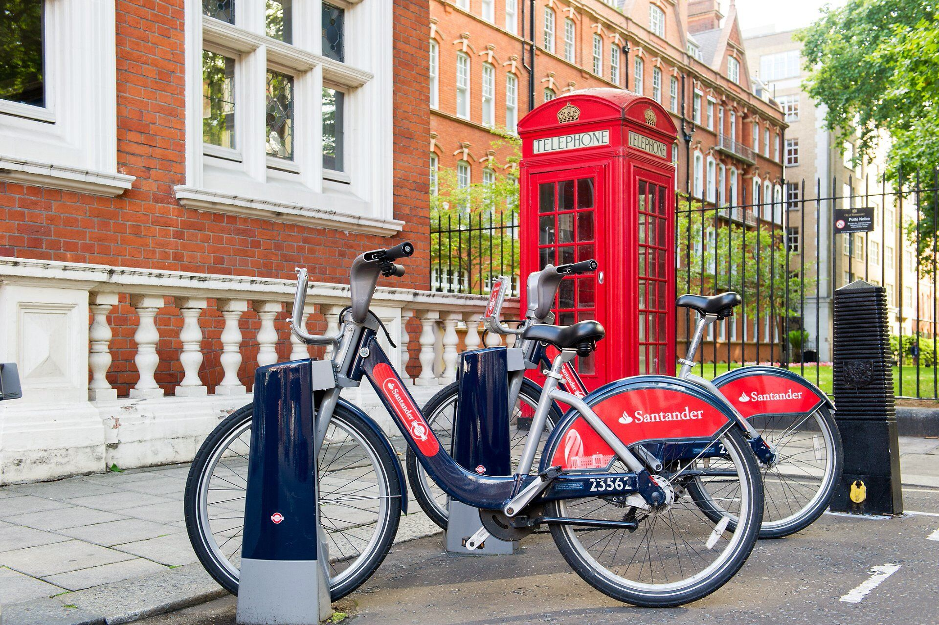 santander bicycles london and red telephone box outside mayfair library westminster