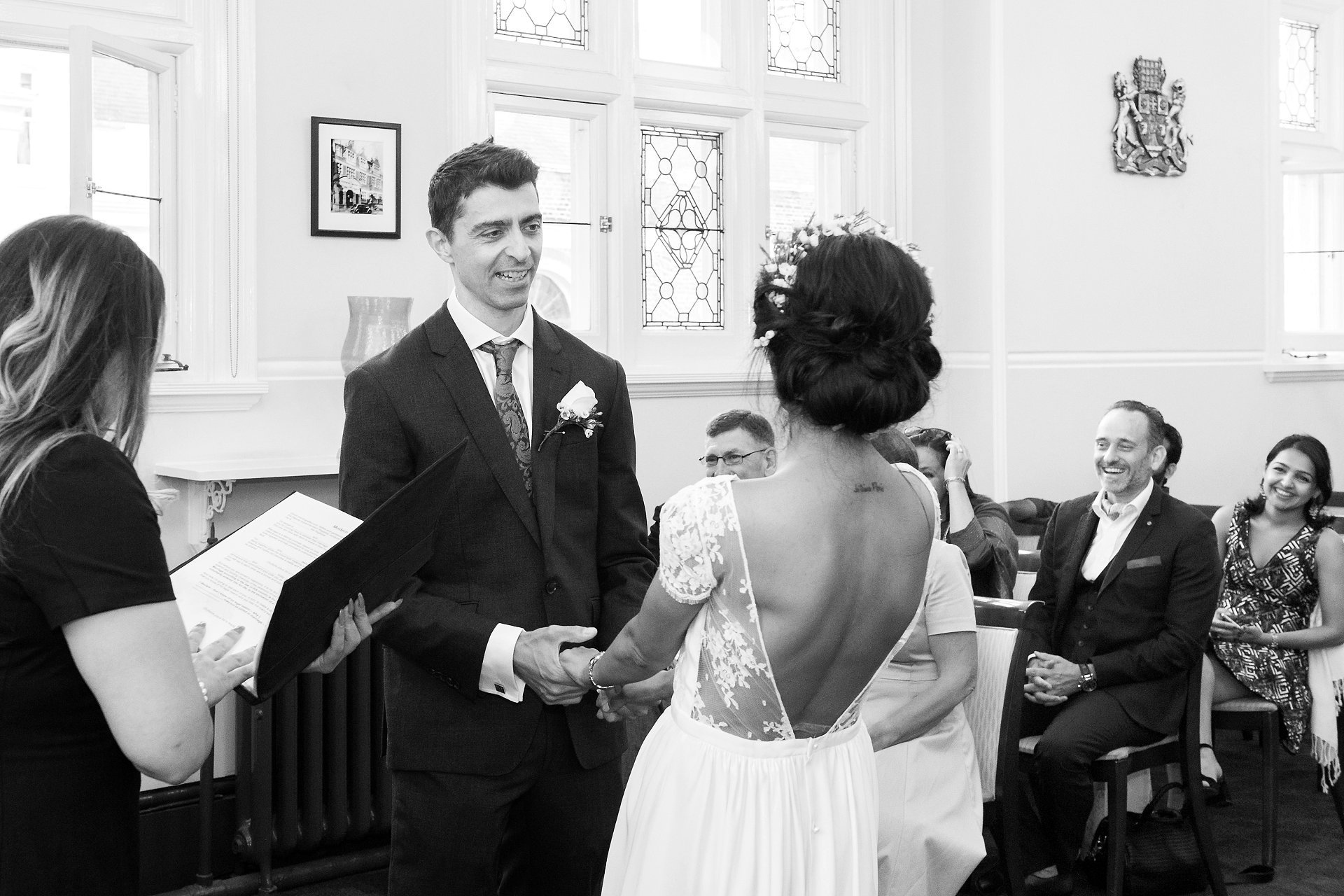 wedding guests laugh during this civil wedding by mayfair wedding photographer emma duggan