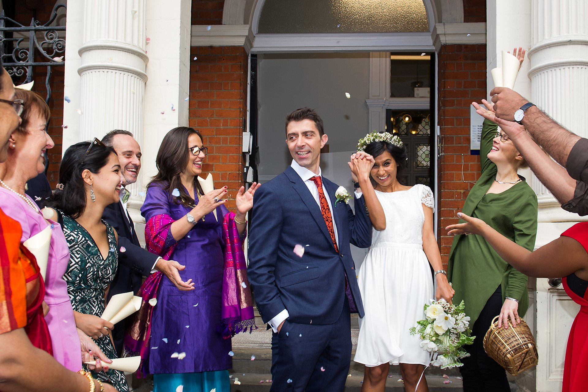 westminster registry office wedding photography and confetti outside mayfair library