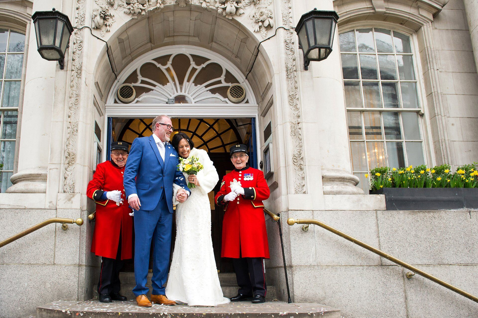 an elopement wedding at chelsea old town hall with just chelsea pensioners as witnesses