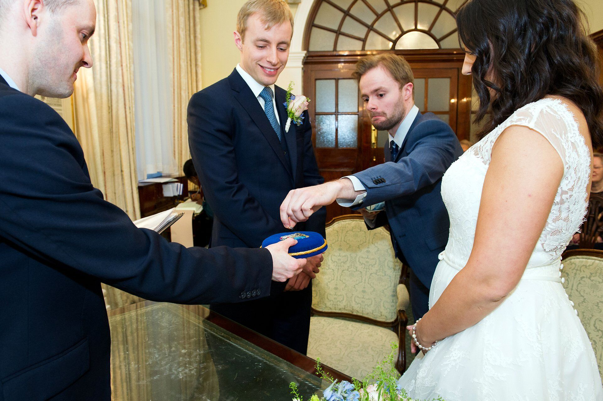 best man delivers wedding rings during chelsea register office wedding
