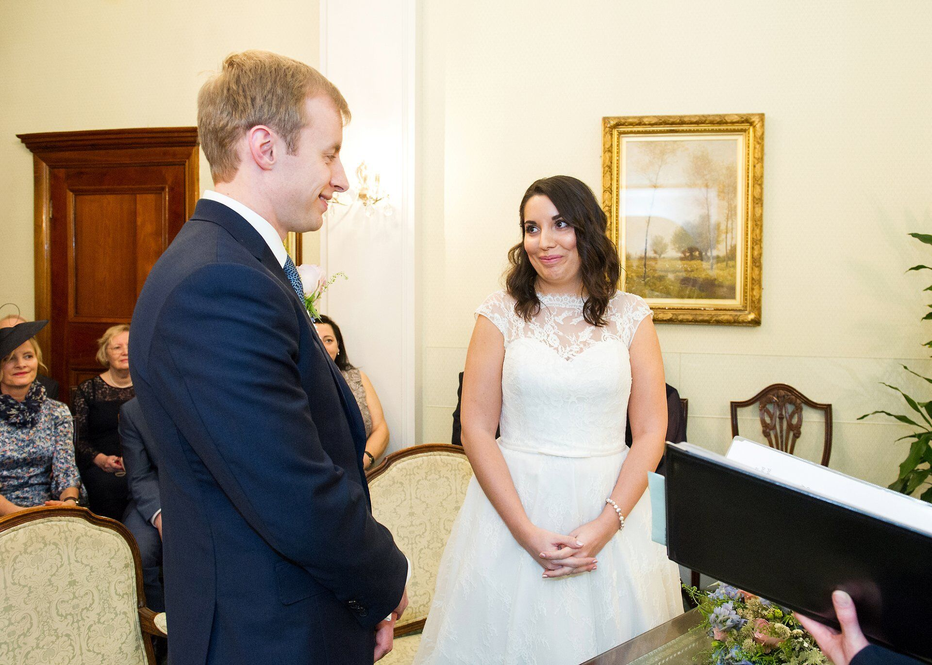bride and groom exchange vows at chelsea register office
