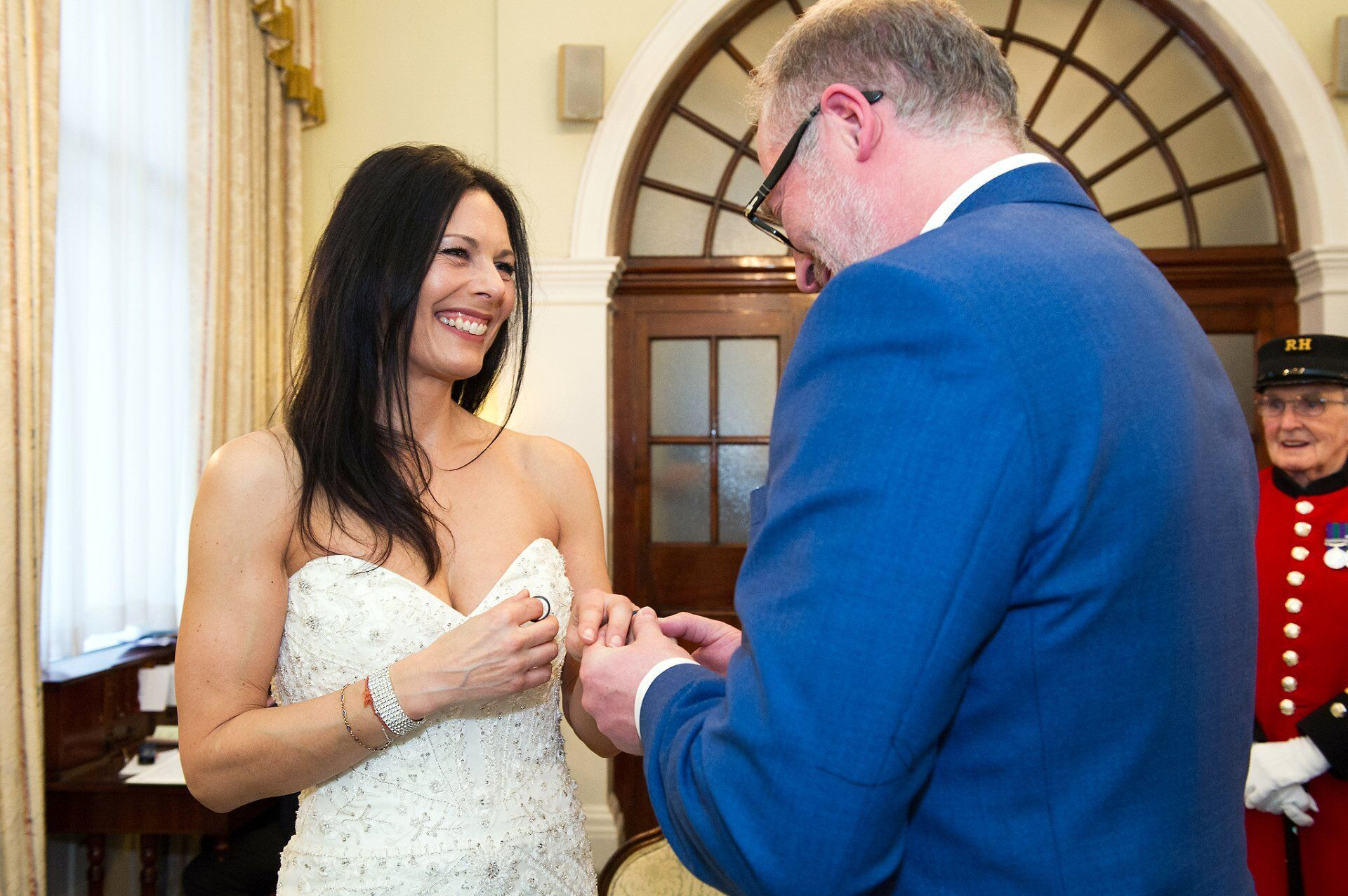 bride and groom exchanging rings during chelsea wedding
