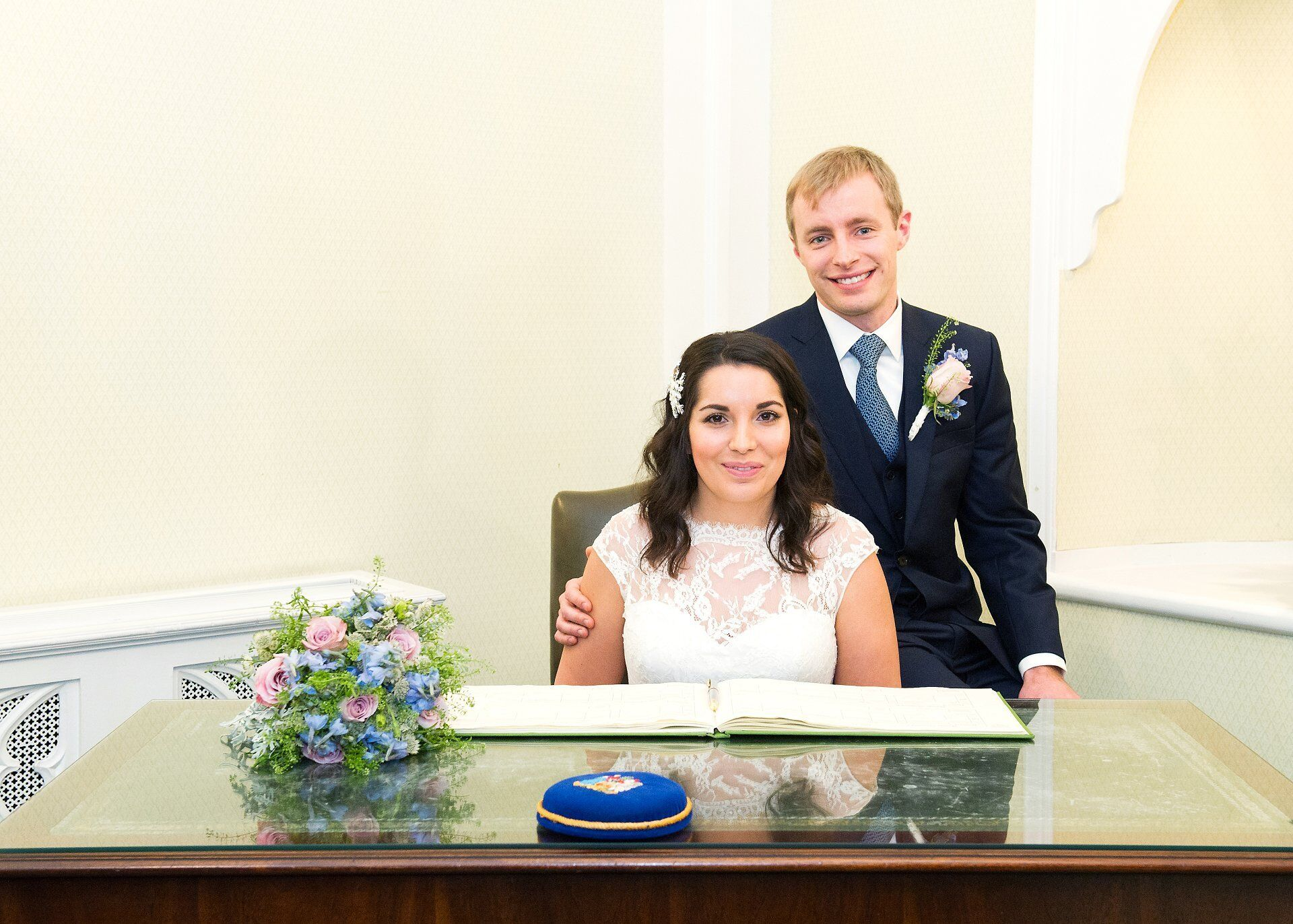 bride and groom in chelsea register office with official register