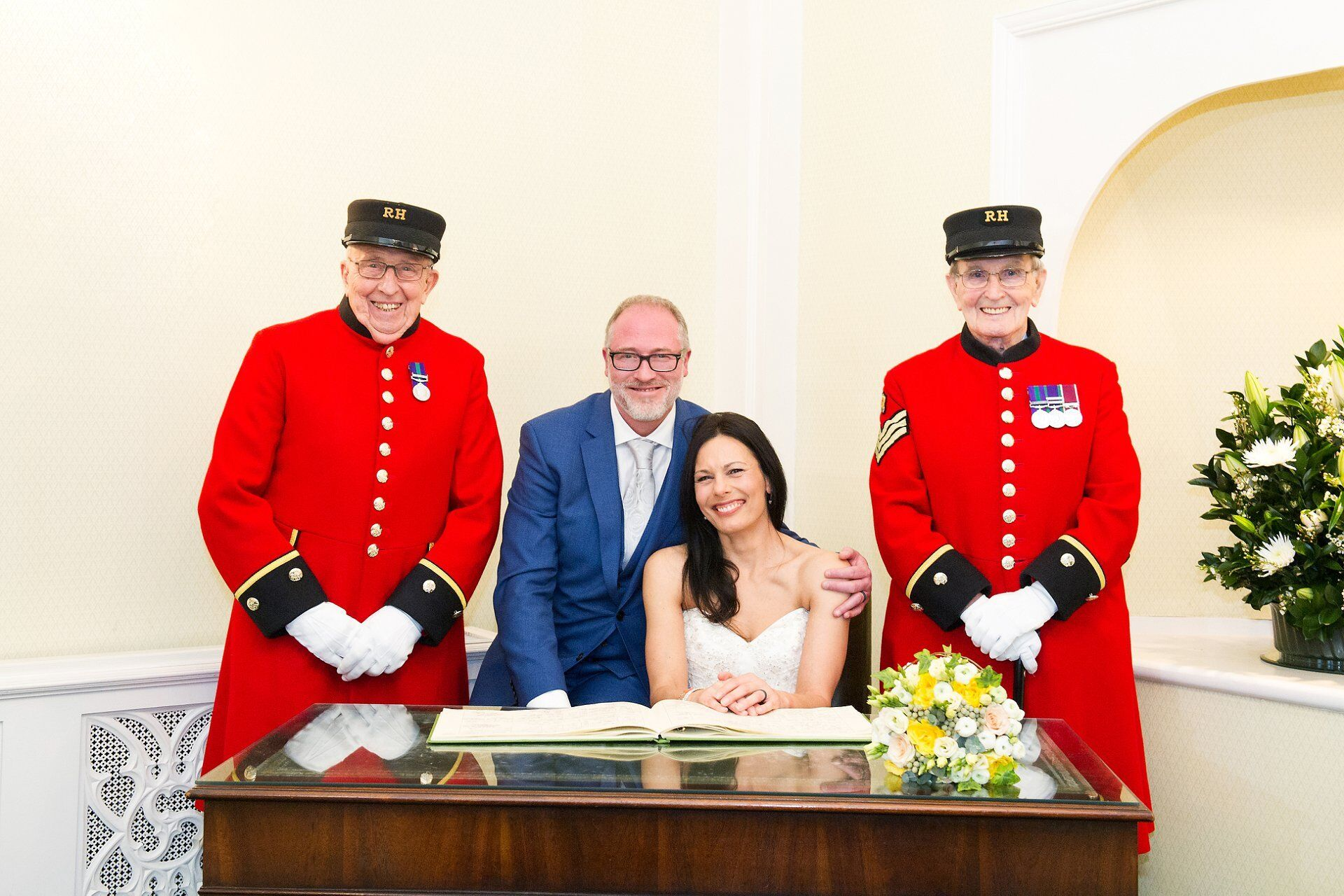 bride and groom in rossetti room at chelsea registry office with two chelsea pensioners