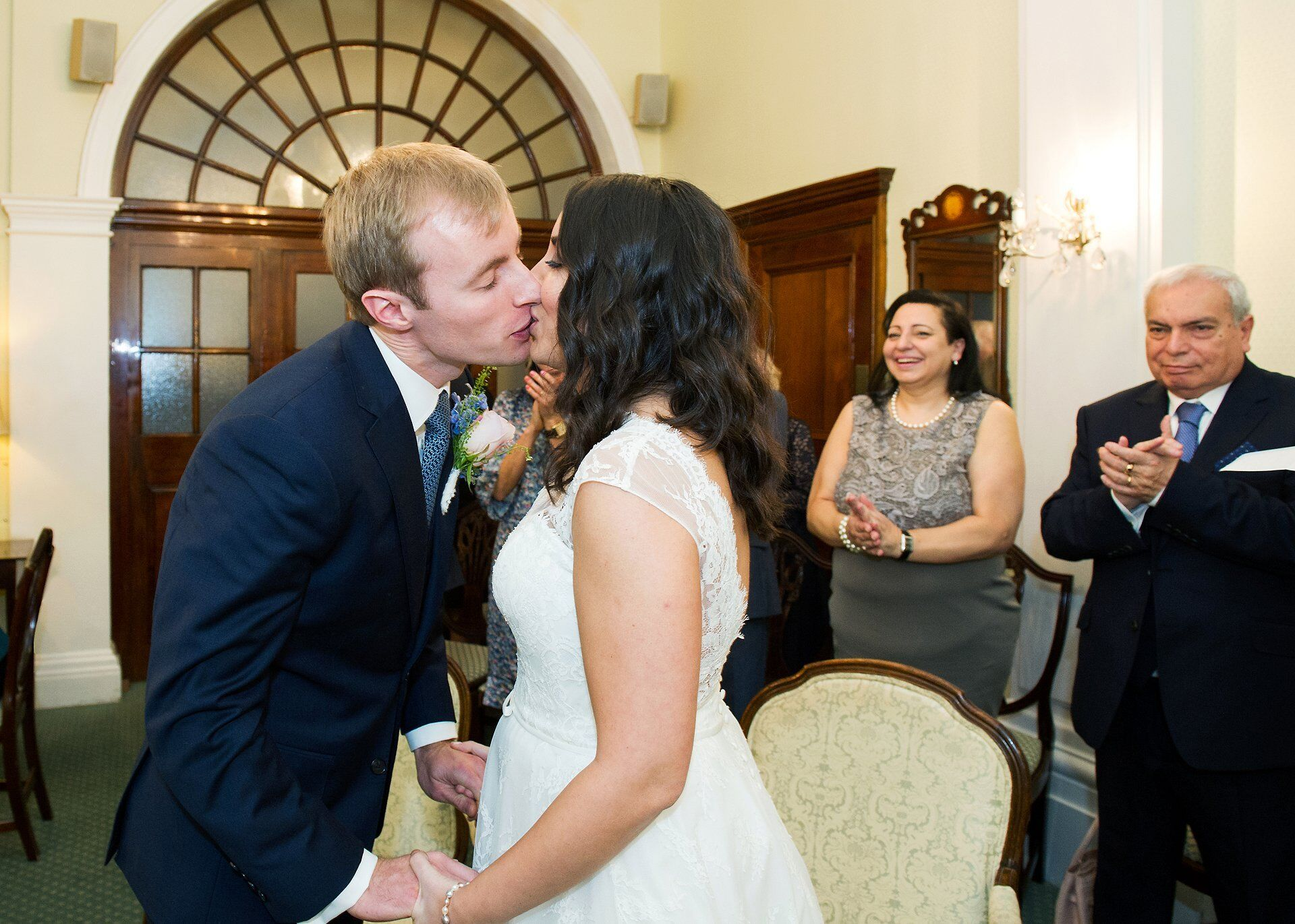 bride and groom kiss during chelsea old town hall civil wedding ceremony