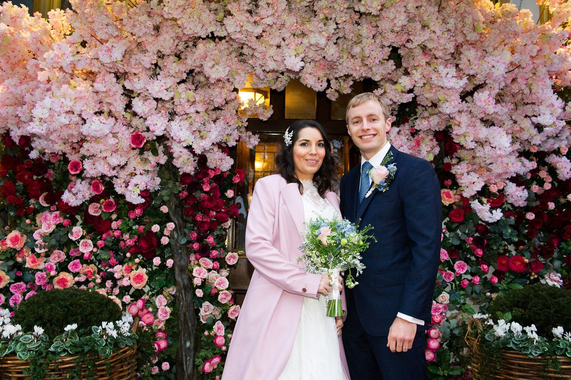 bride and groom outside the ivy chelsea garden wedding photographer after spring wedding