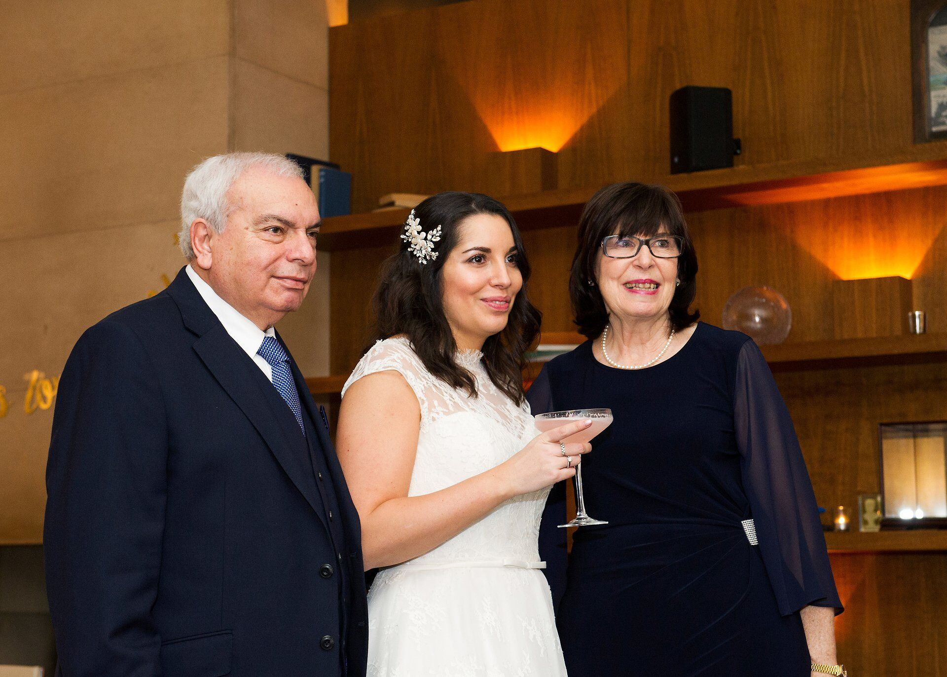 bride and parents in bluebird chelsea after chelsea register office wedding