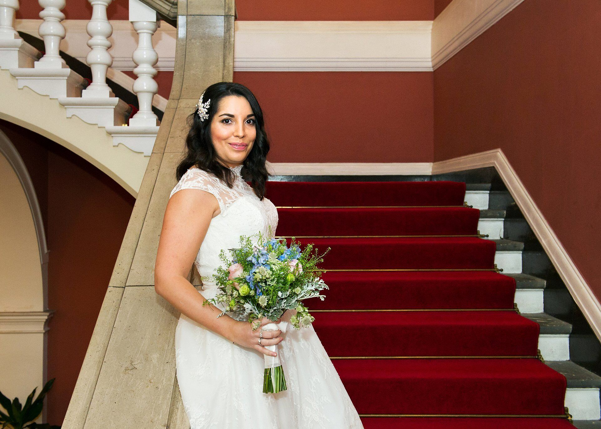 bride in silk and lace tea length wedding dress in chelsea register office