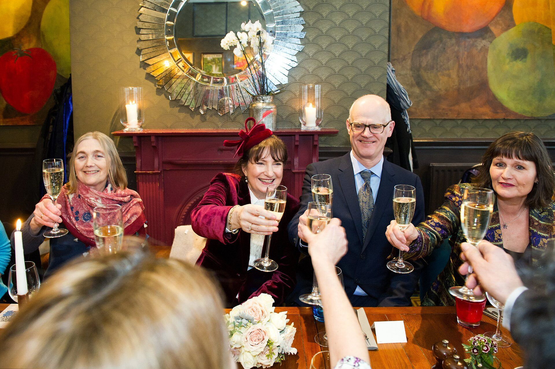 chelsea pub venue for small wedding in london - bride and groom with champagne