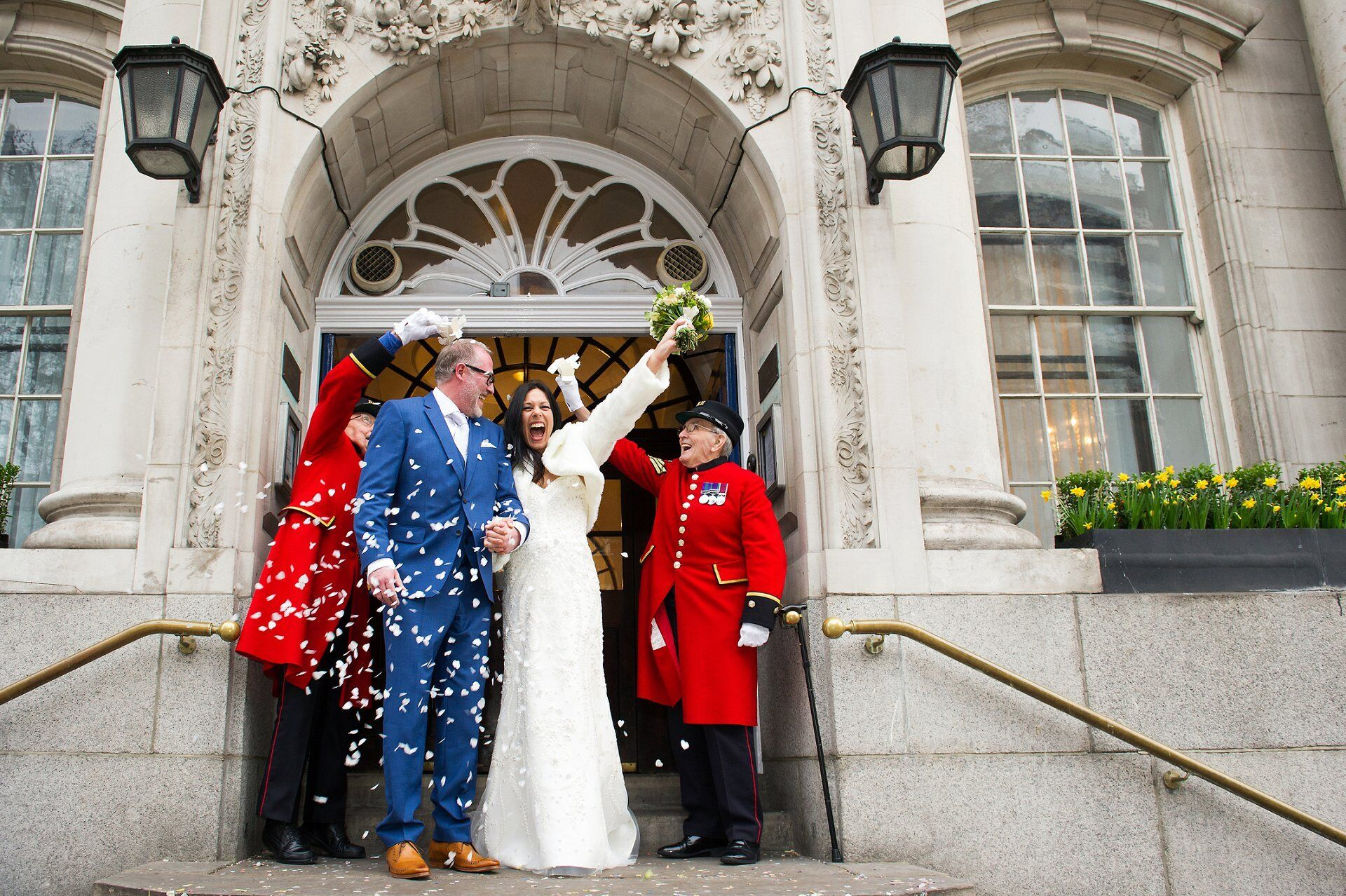 chelsea register office wedding photographer photo of a bride and groom leaving with confetti