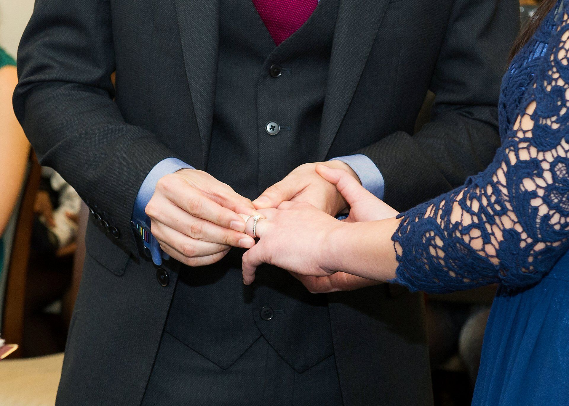 groom places ring on bride's finger mayfair library
