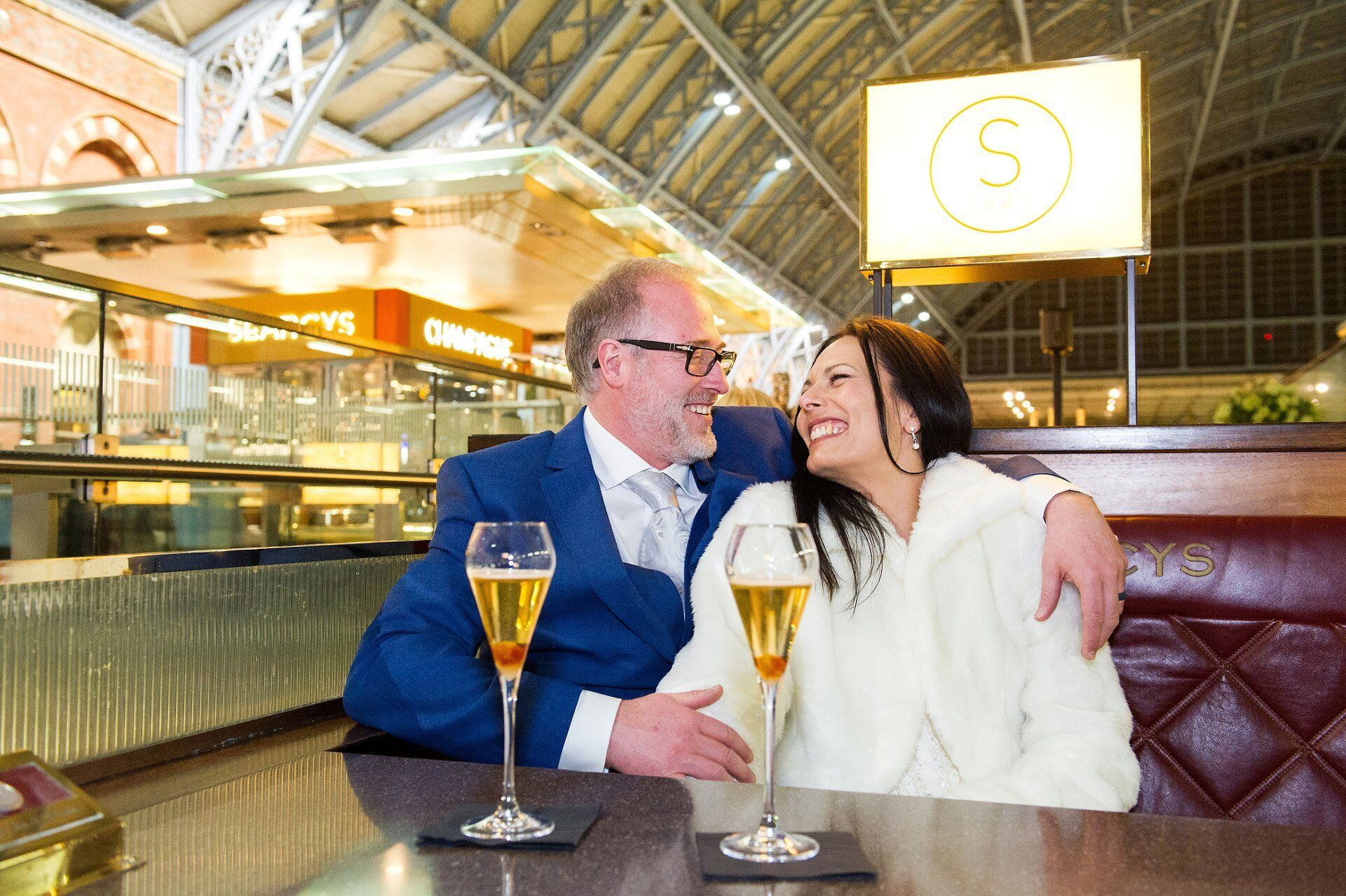 st pancras champagne bar by searcys a bride and groom celebrate their wedding