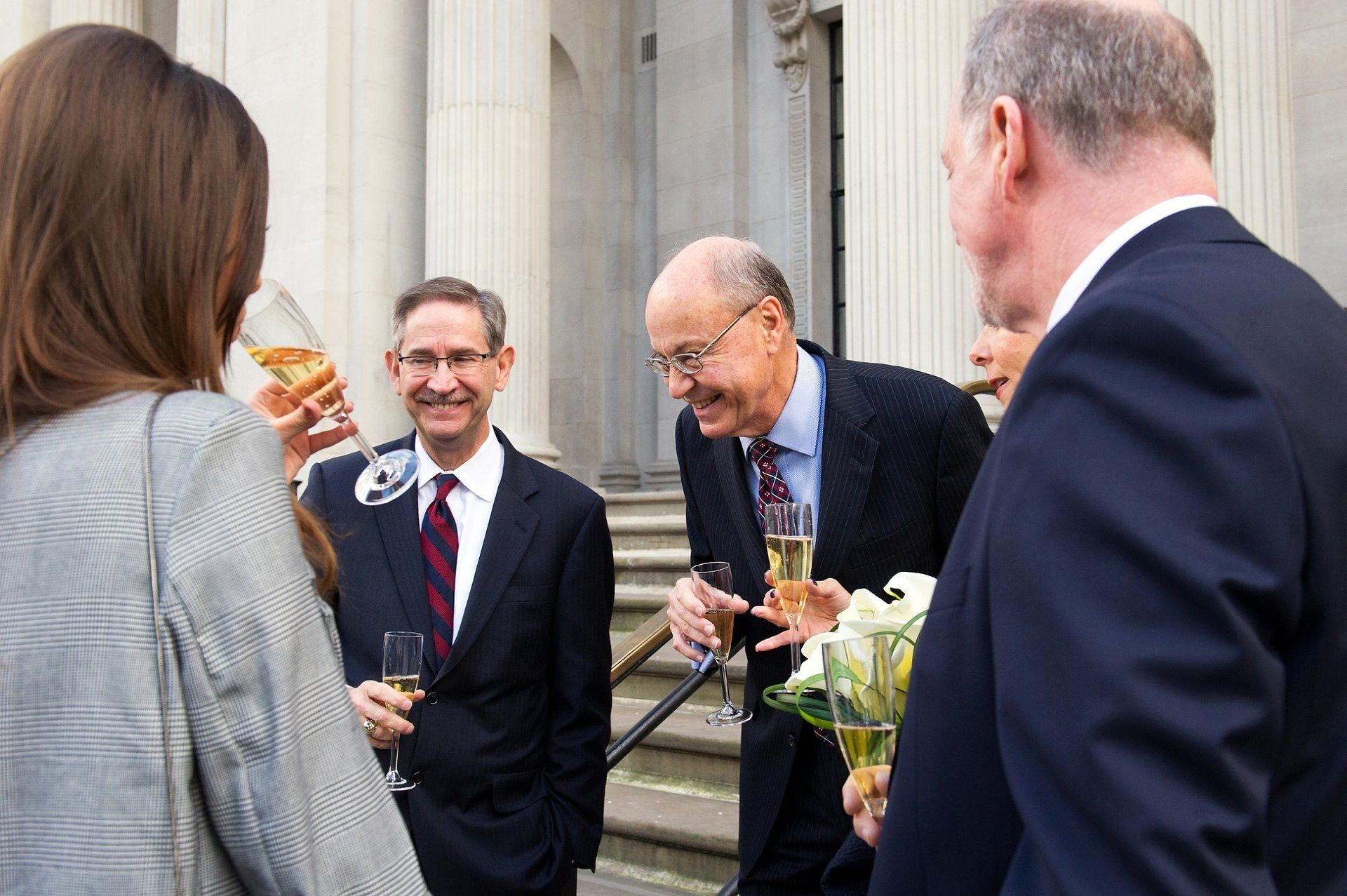 champagne at old marylebone town hall wedding on the iconic steps outside westminster register office