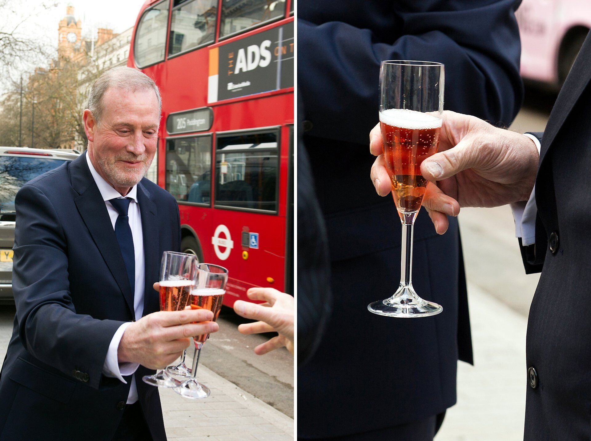 groom gives everyone a glass of champagne outside old marylebone town hall