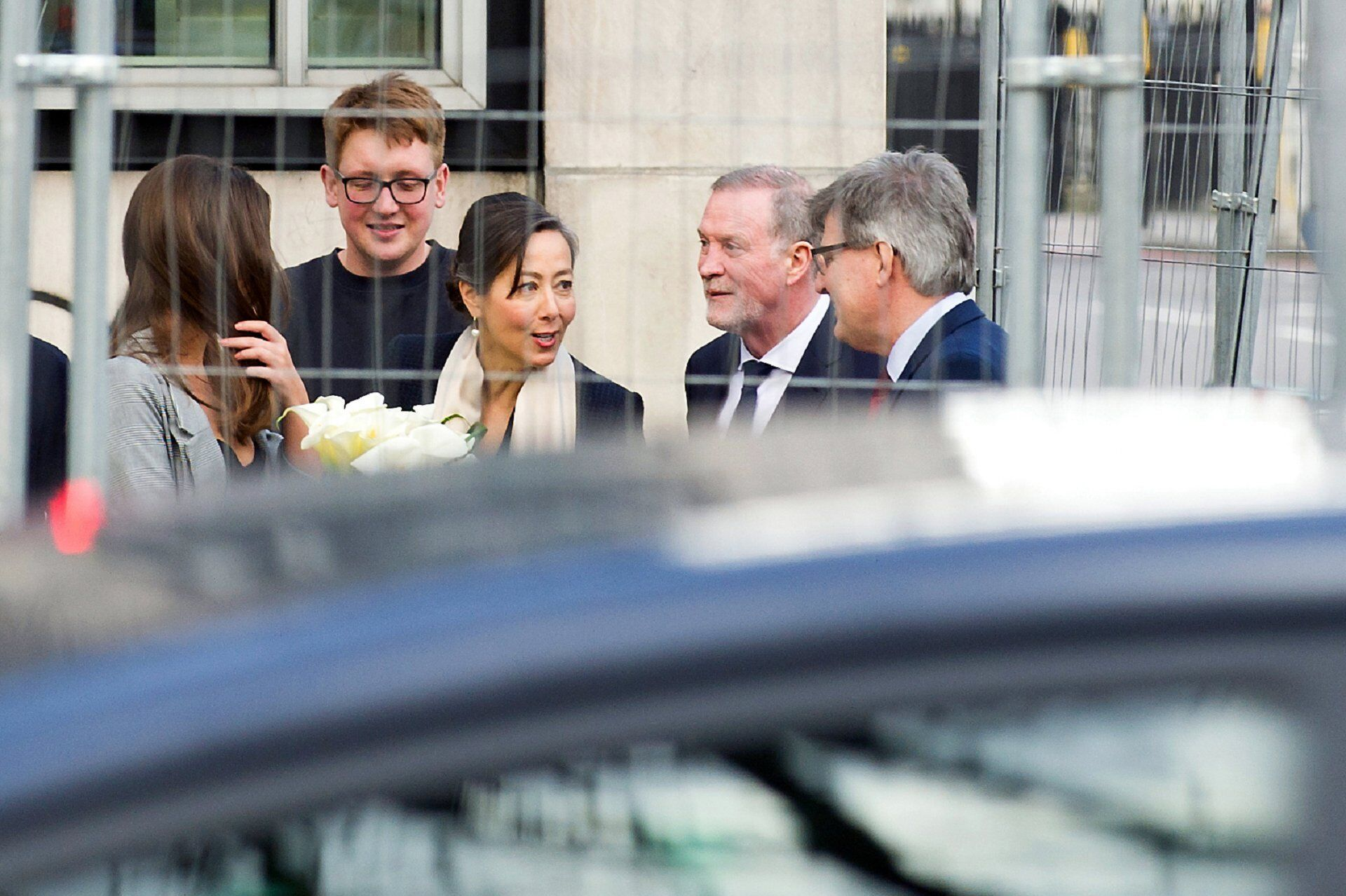 bride and groom arrive with daughter for westminster register office wedding