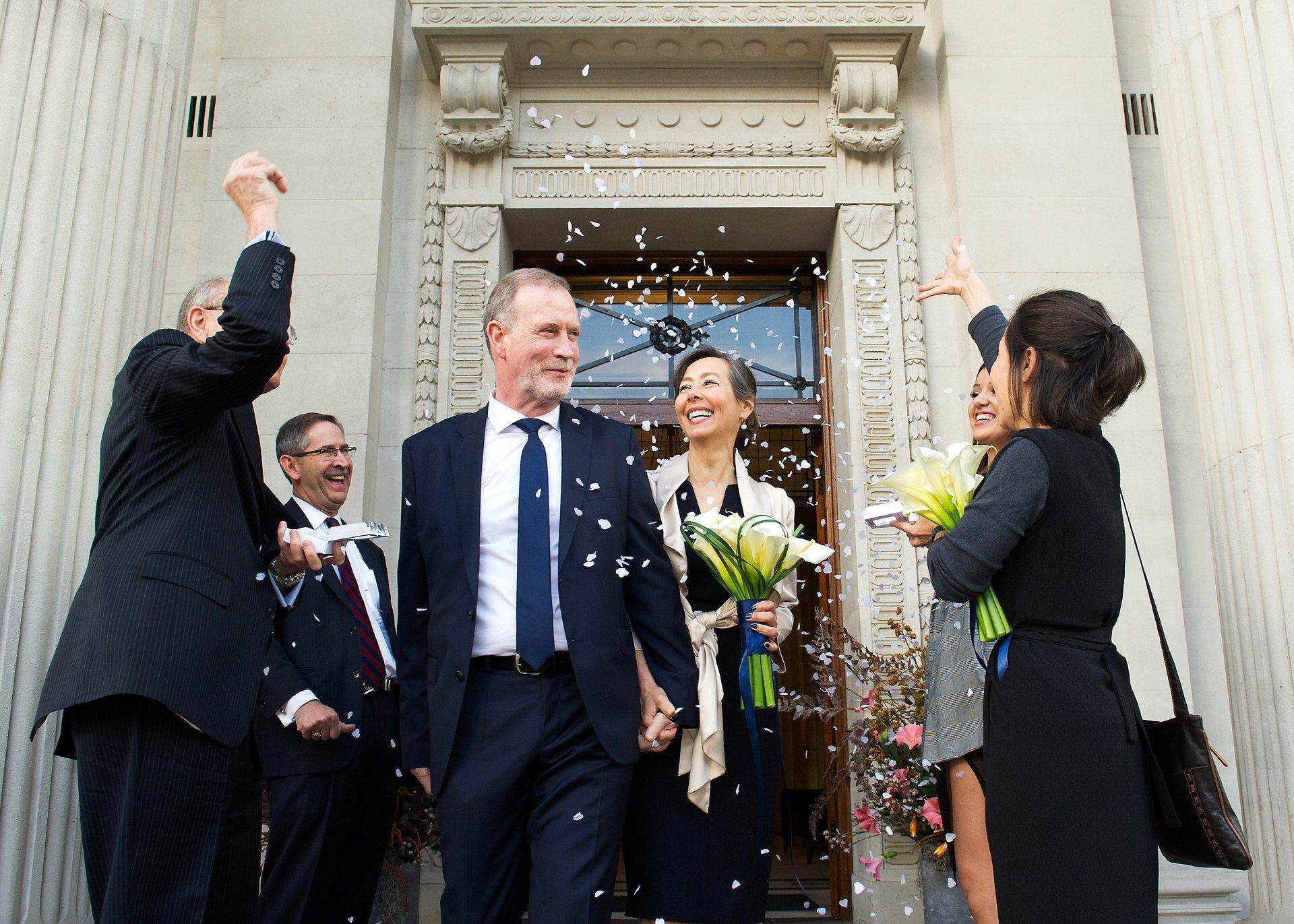 wedding photographer emma duggan captures couple leaving westminster register office with confetti for soho room wedding photography old marylebone town hall