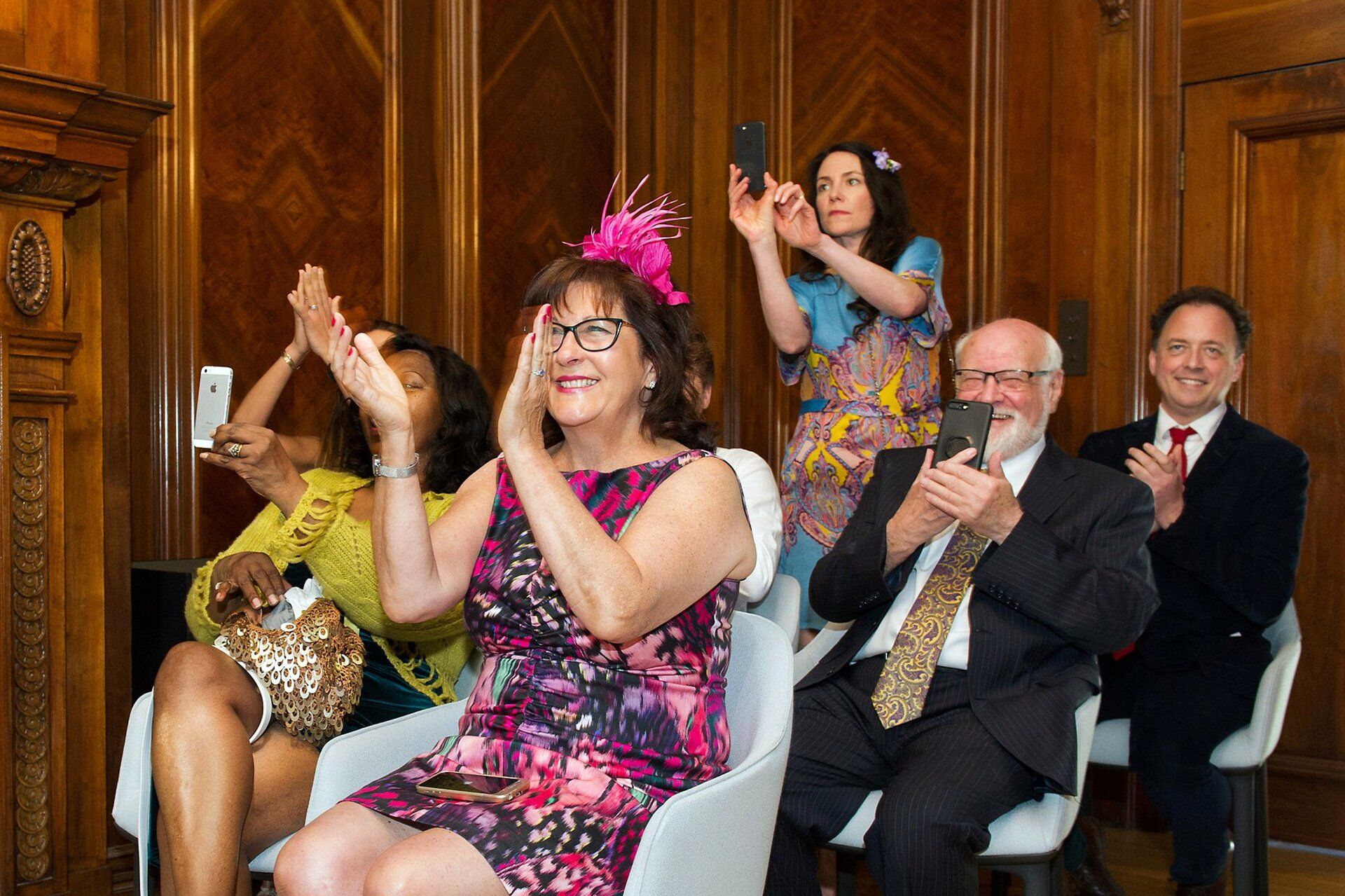 guests clapping and cheering the happy couple in the marylebone room at old marylebone town hall