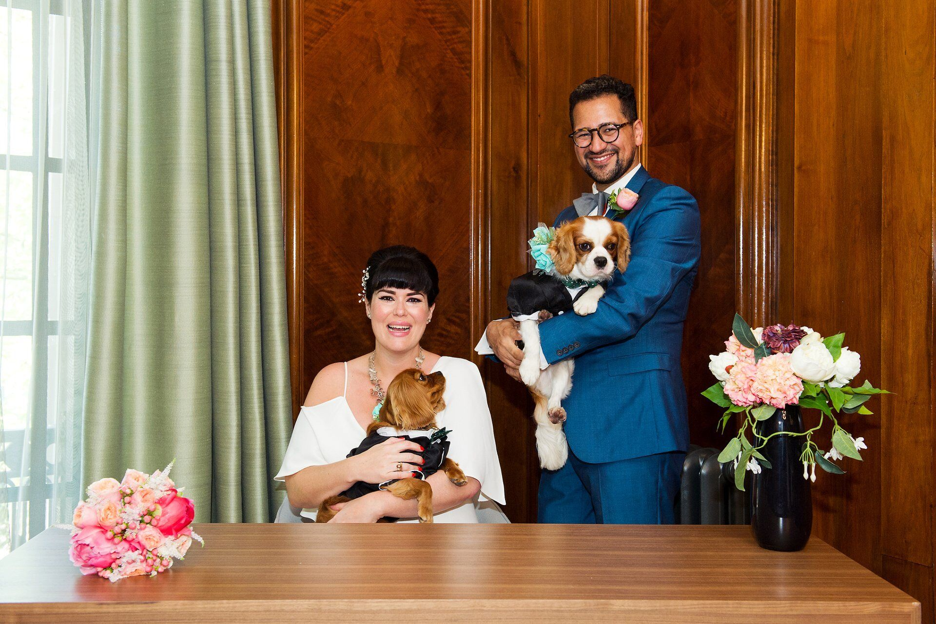 marylebone room wedding photography with bride and groom and their two cavalier king charles spaniel puppy dogs signing the register by old marylebone town hall wedding photographer emma duggan
