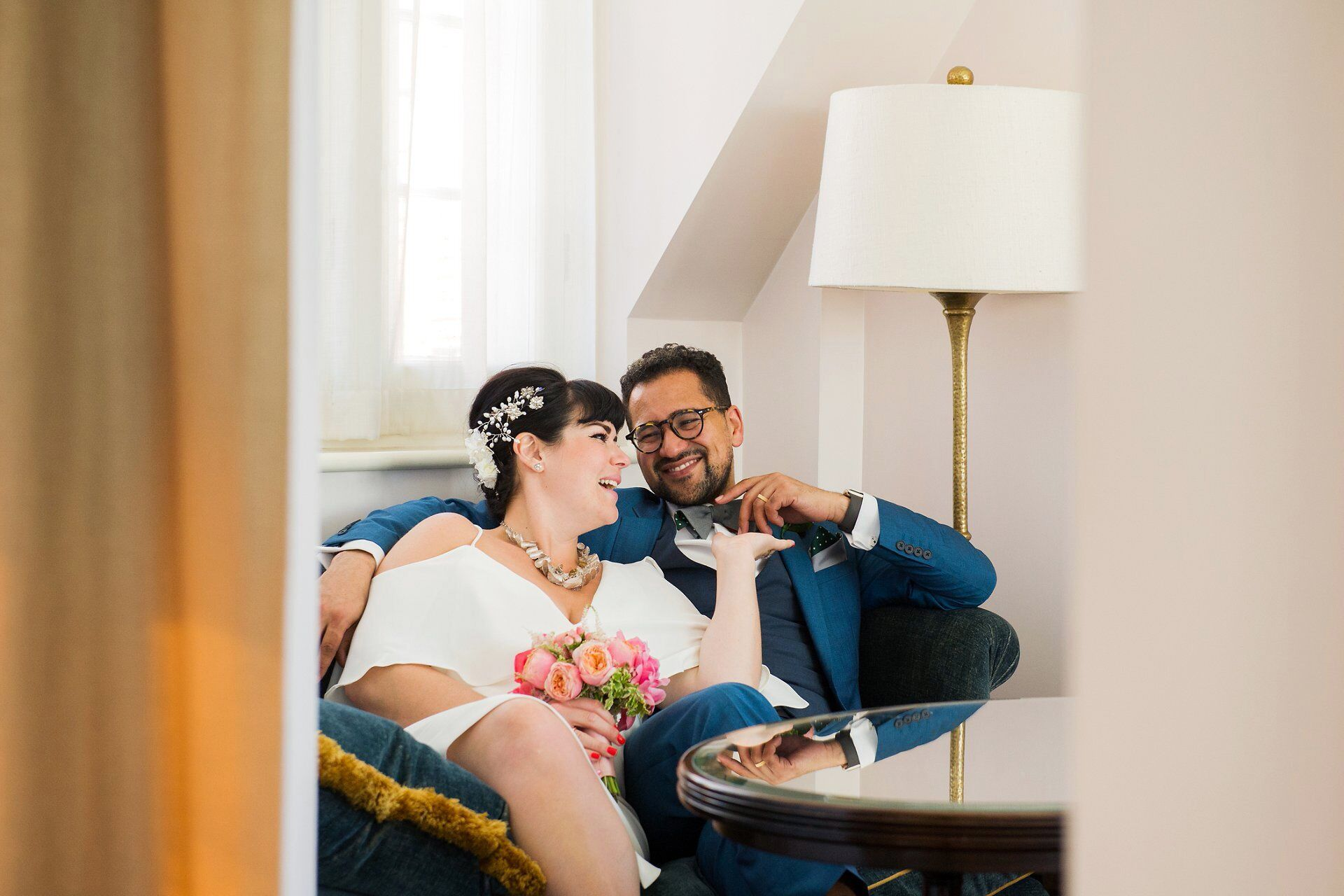 marylebone room wedding photography and chiltern firehouse wedding reception photographer emma duggan with the couple relaxing in their bedroom