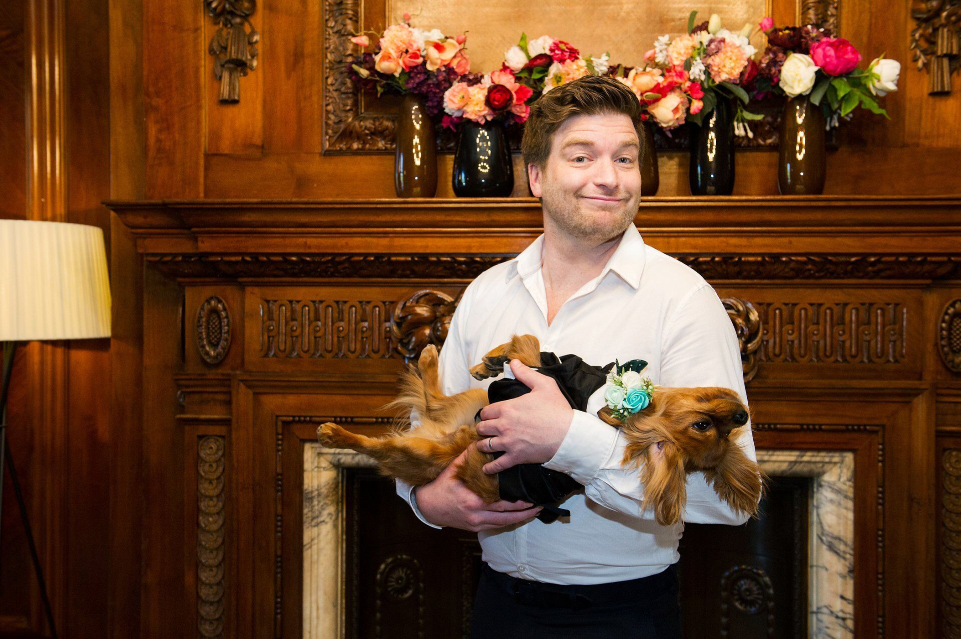 guest with cavalier king charles spaniel puppy at this dog friendly wedding venue in london - marylebone room wedding photography at old marylebone town hall