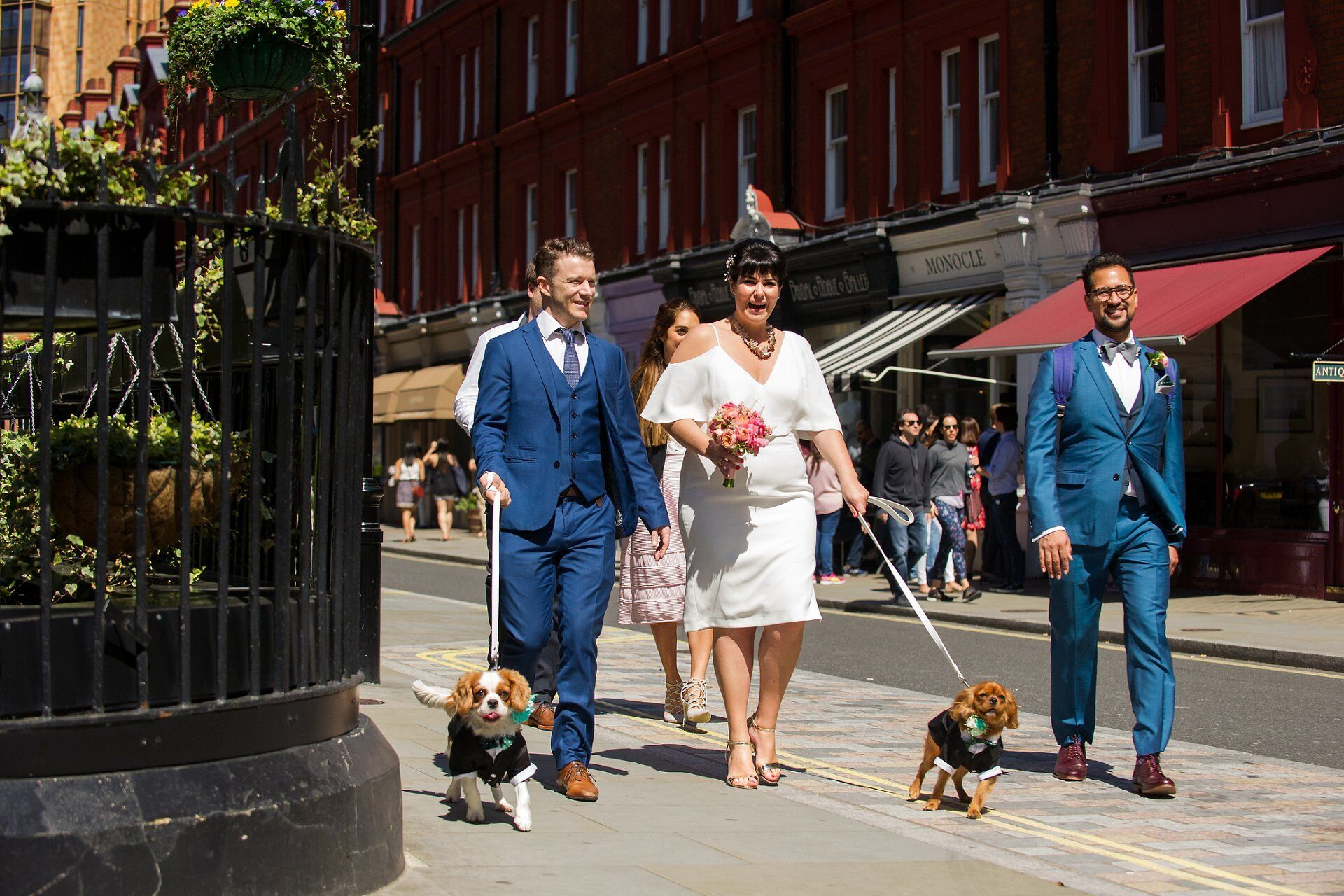 bride and groom walking their two puppy dogs to the chiltern firehouse for lunch to celebrate their marylebone room wedding