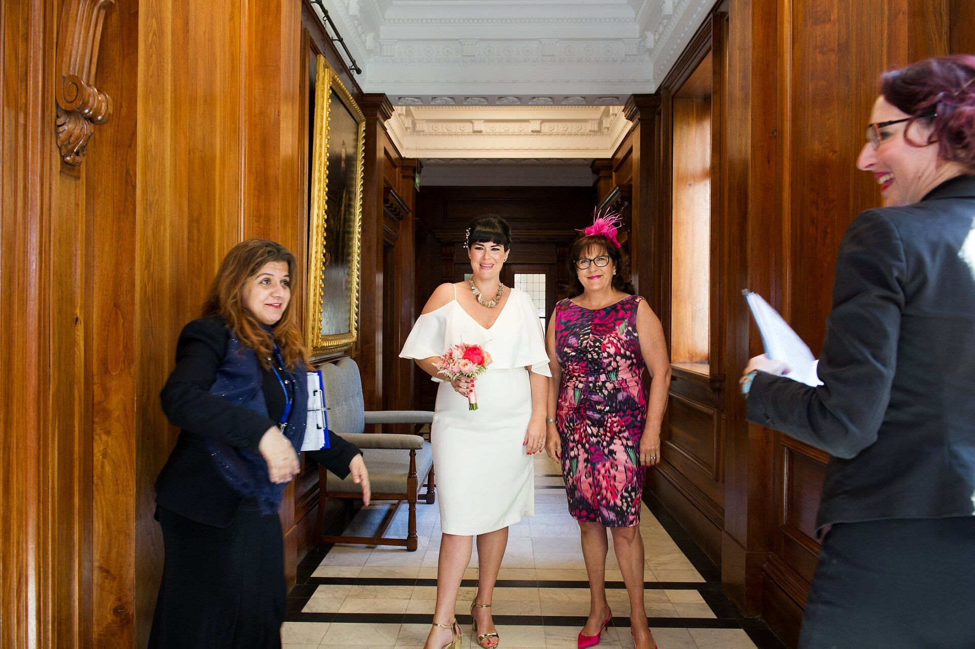 bride and her mother wait to enter the marylebone room at old marylebone town hall