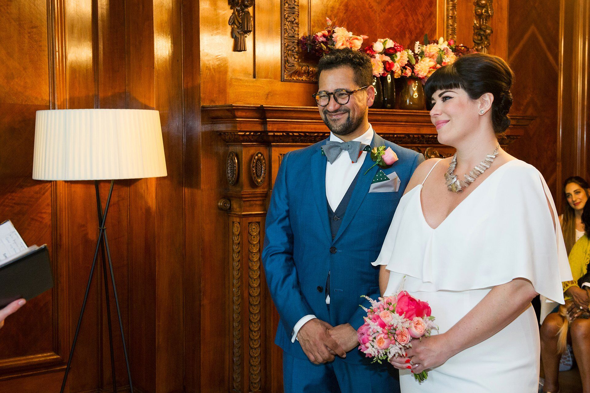 bride and groom in stylish vintage inspired outfits at westminster register office (wedding photography for small intimate london weddings)