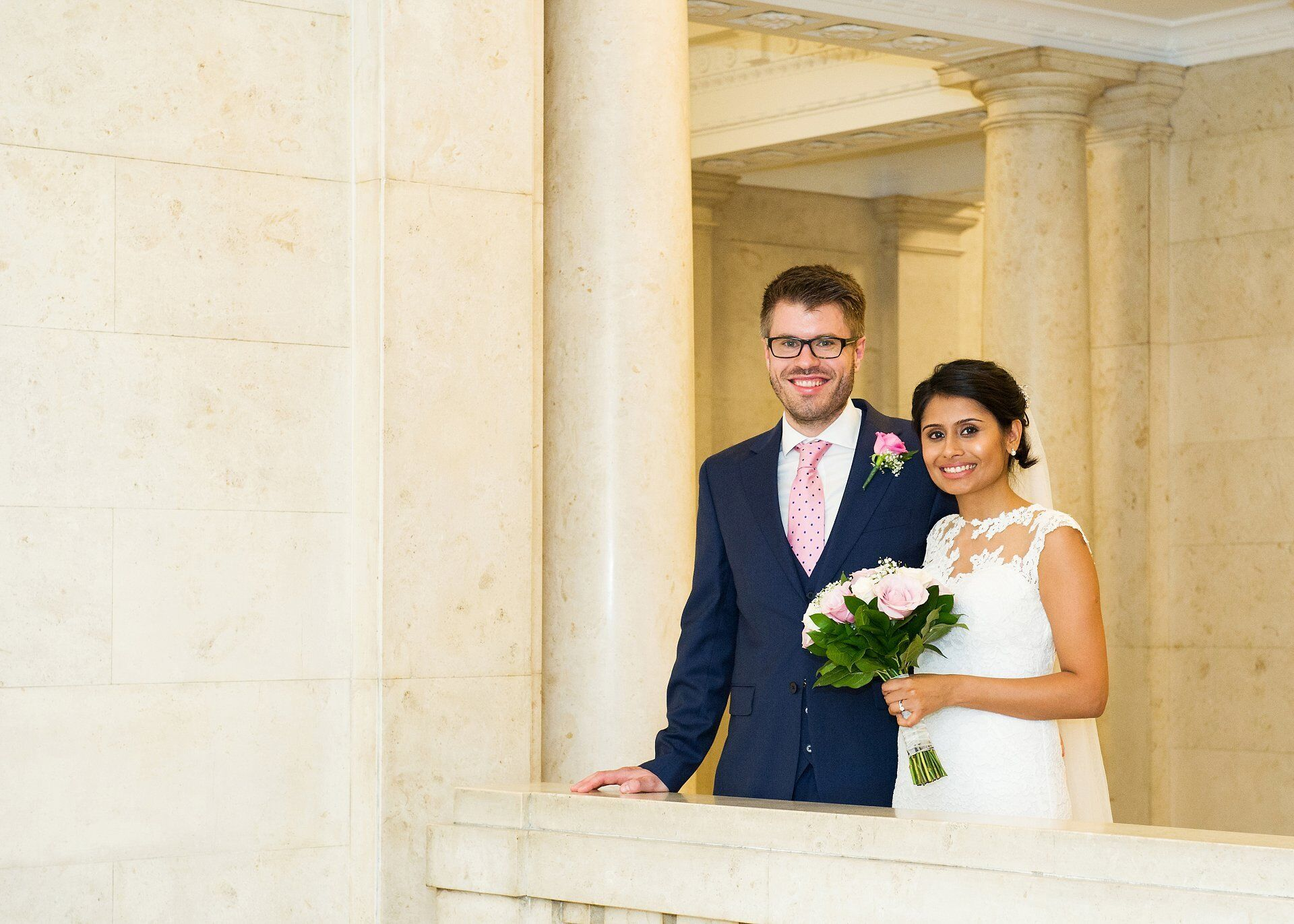 bride and groom on first floor balcony of old marylebone town hall a day to remember westminster