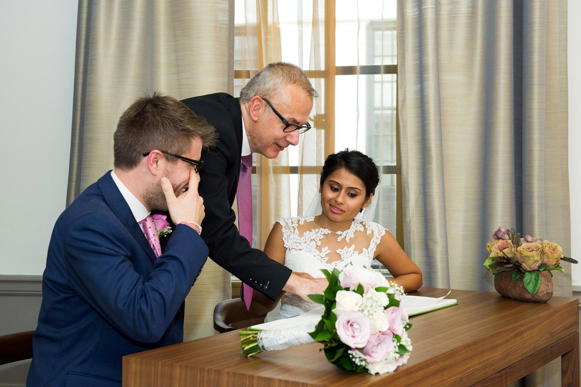 bride and groom sign register london wedding photography by the hour for smaller more intimate weddings