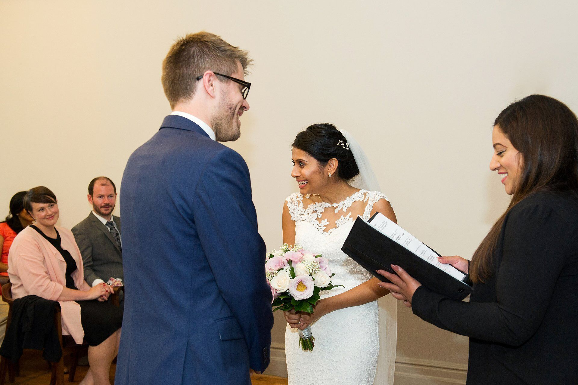 bride smiling towards guests during westminster wedding ceremony