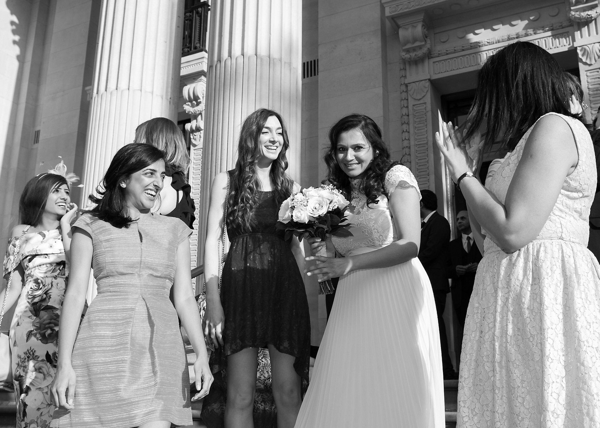 bridesmaid catches bouquet thrown on steps outside old marylebone town hall
