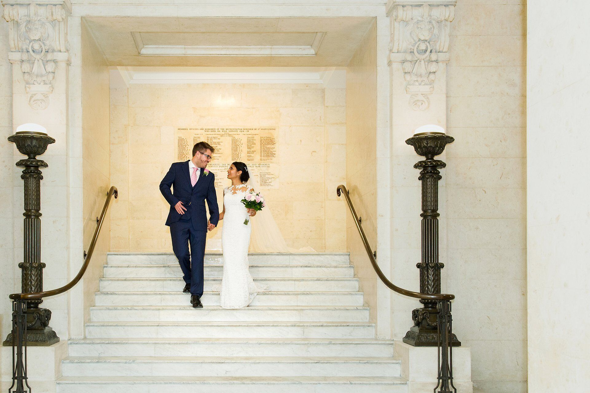 elopement wedding photogrpahy london couple walking down marble staircase at old marylebone town hall