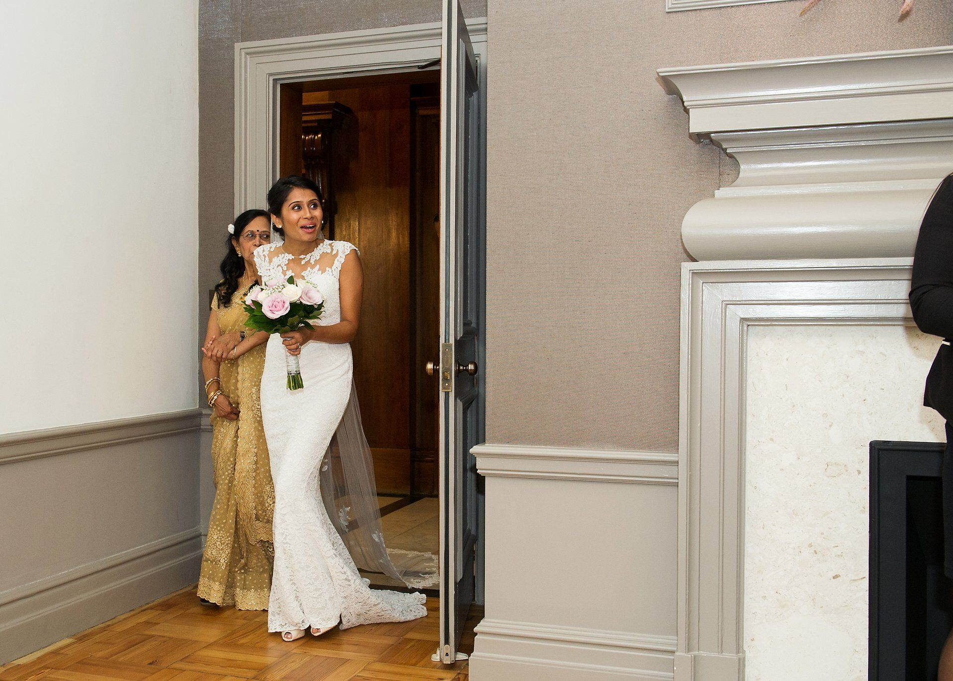 old marylebone town hall wedding photography a bride sees groom for first time as she enters mayfair room