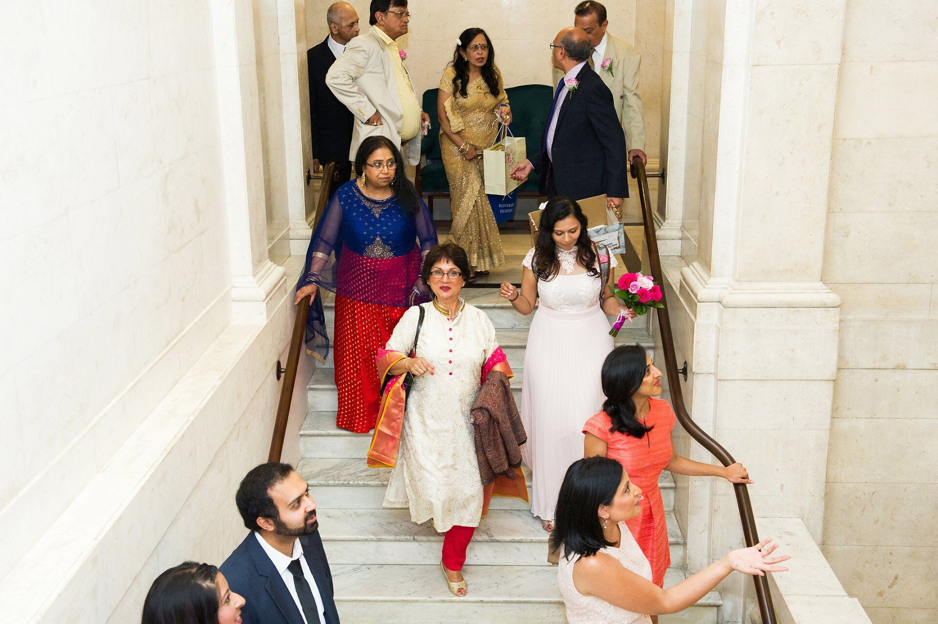 wedding photography small wedding in central london guests on marble staircase inside old marylebone town hall