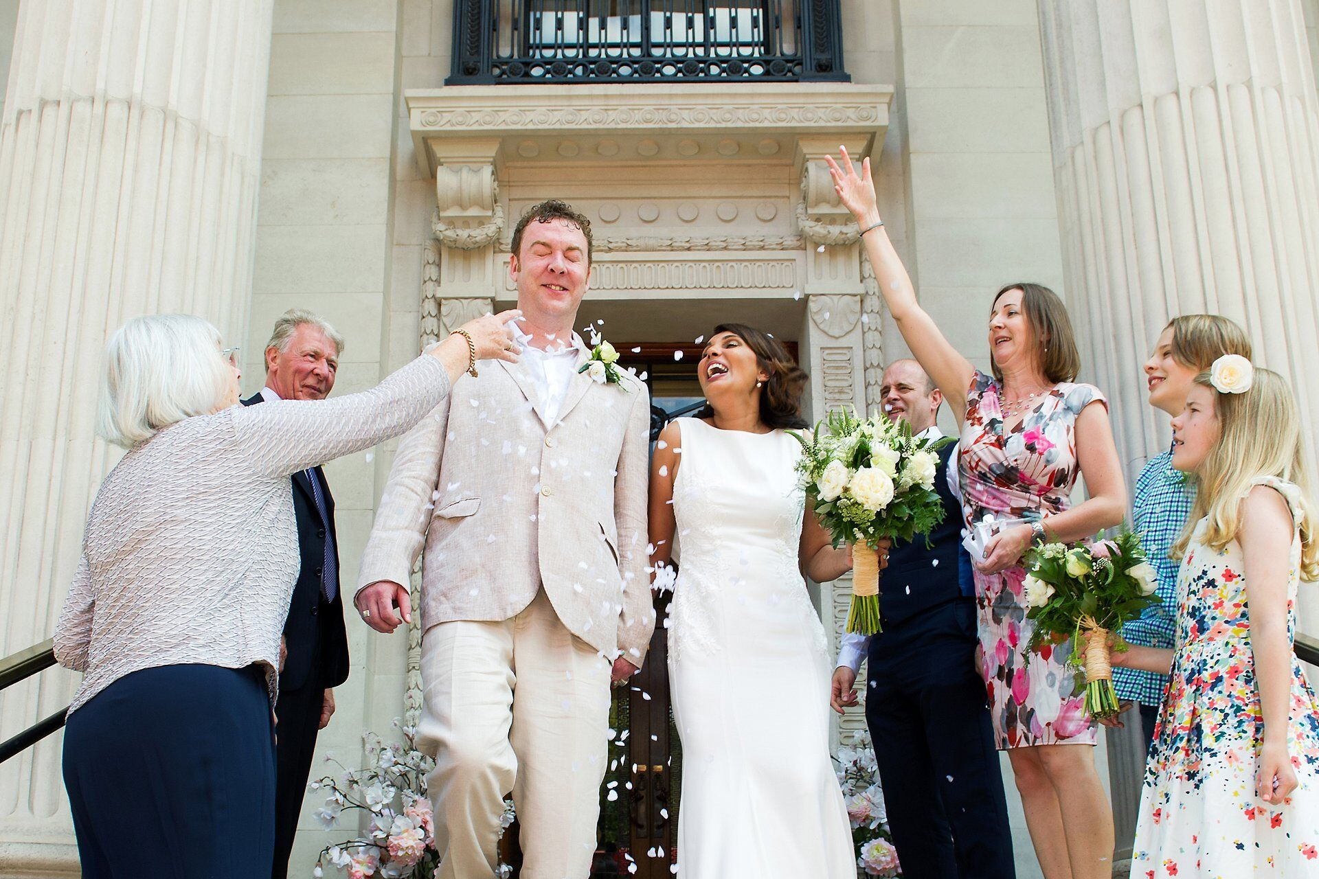 a bride and groom dodge confetti at westminster register office