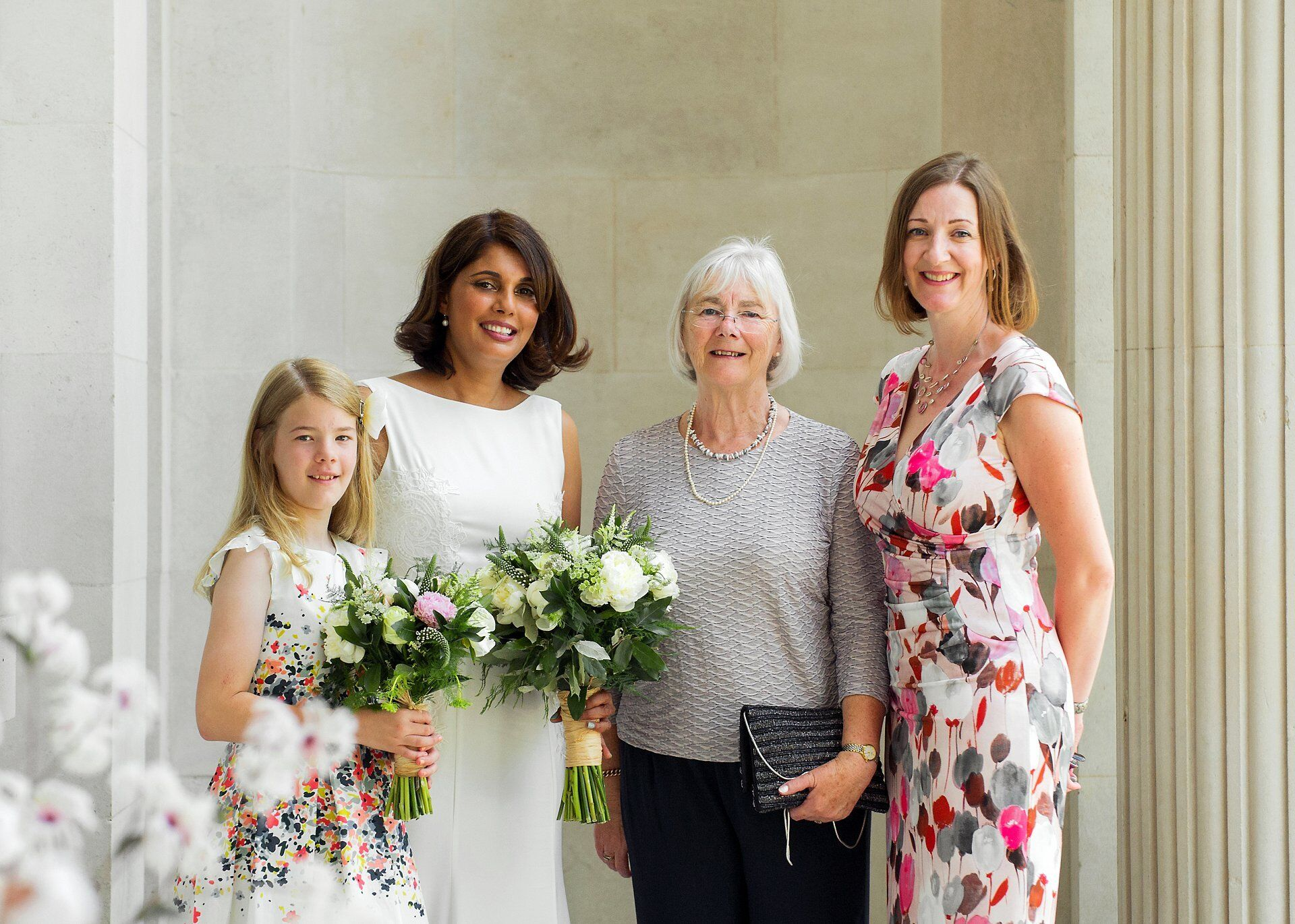 bride and family outside old marylebone town hall under the romanesque fluted columns