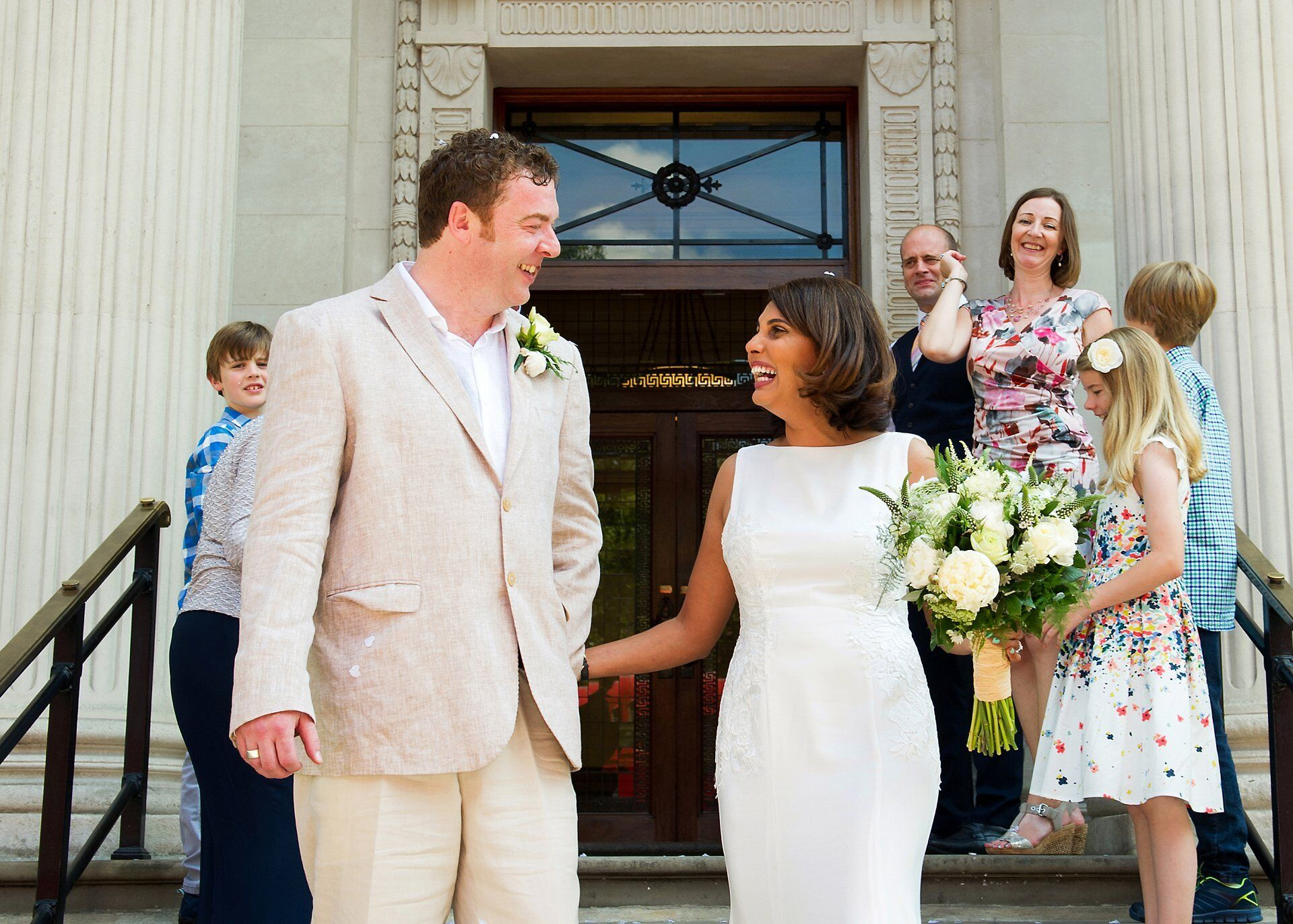 bride and groom leaving old marylebone town hall as husband and wife