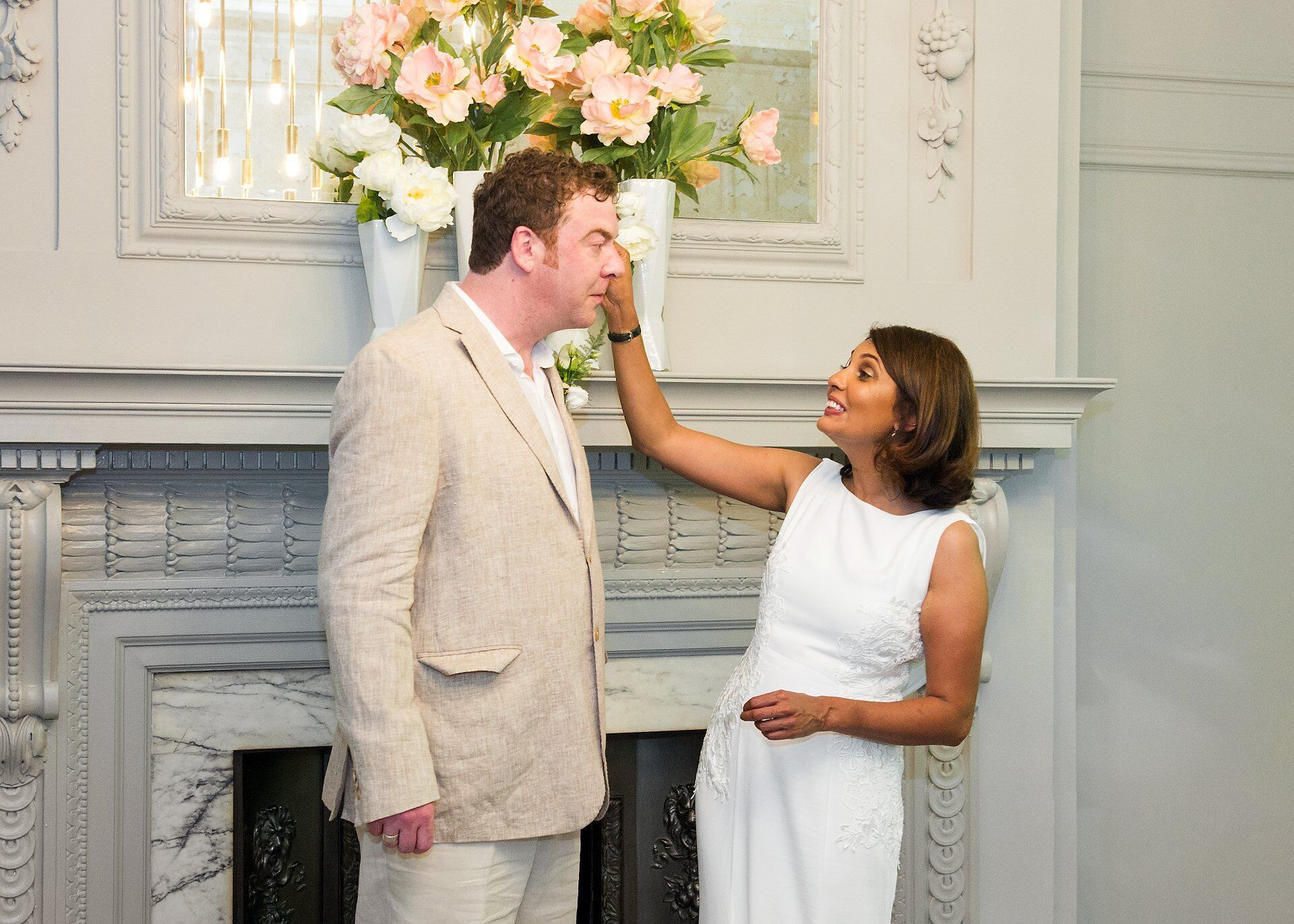 bride mops groom's brow during world cup quarter final wedding at old marylebone town hall