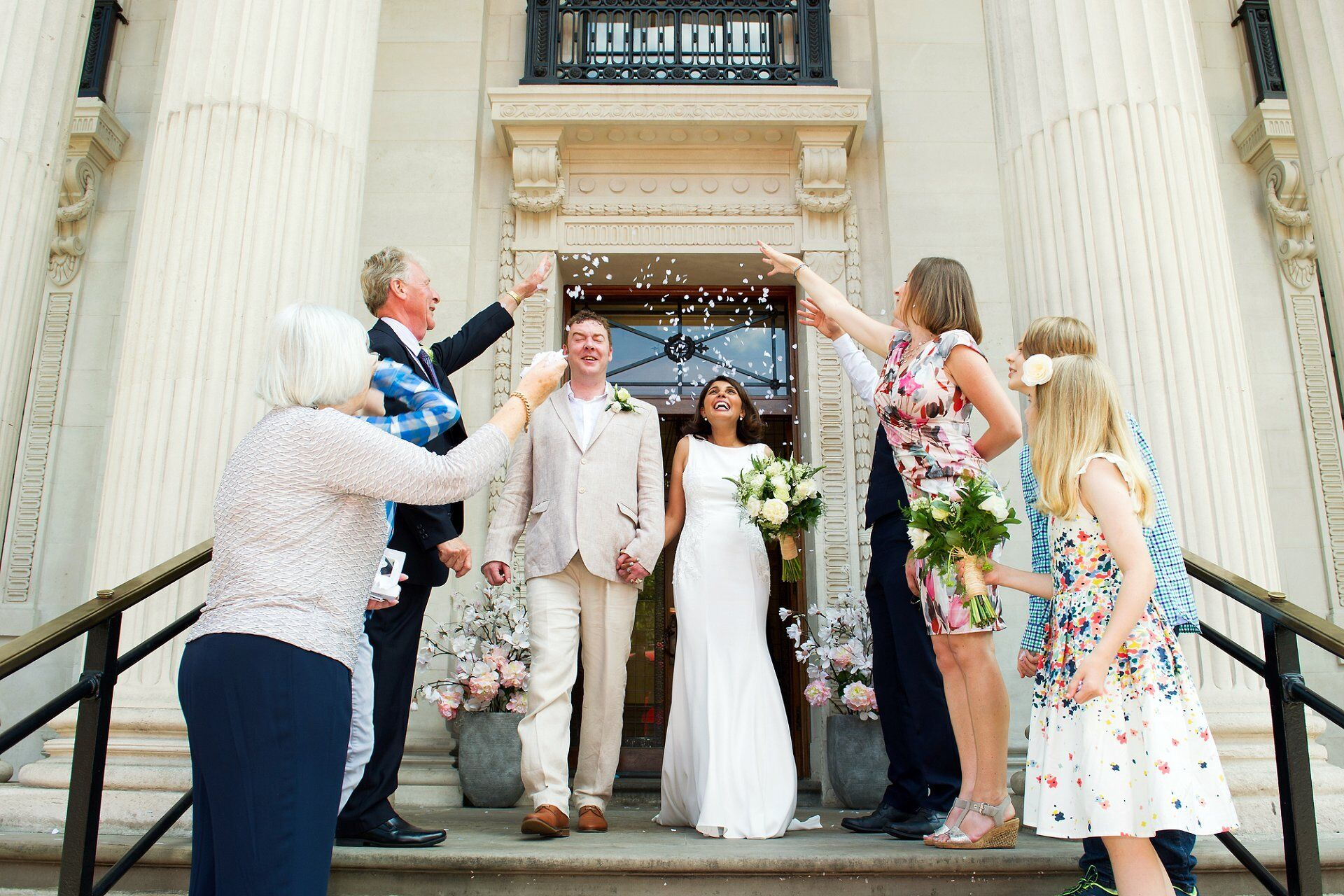confetti on the iconic old marylebone town hall steps by recommended supplier emma duggan (an old marylebone town hall wedding photographer specialist, especially soho room wedding photography))