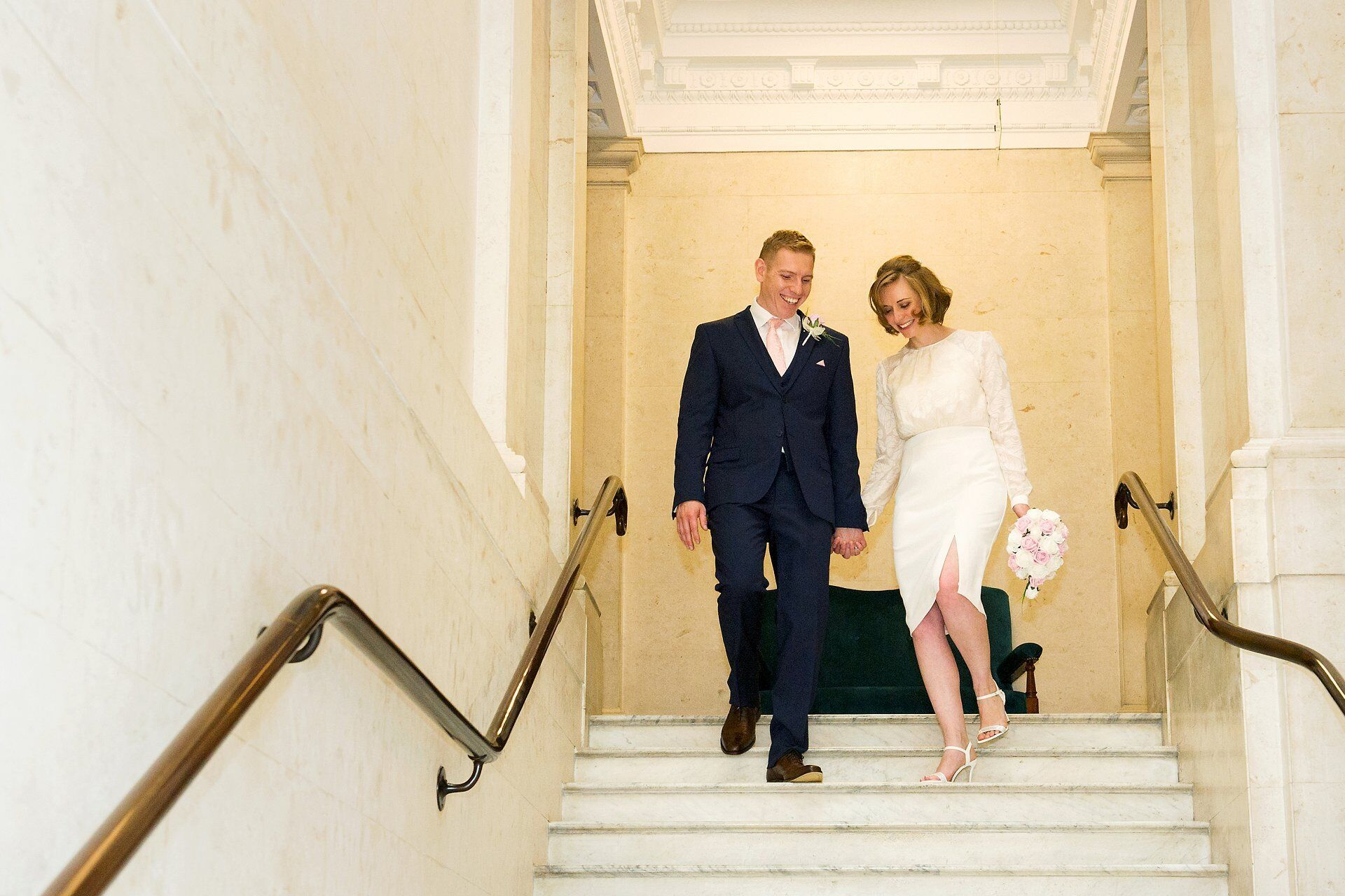 famous staircase with bride and groom old marylebone town hall wedding photogrpahy specialist emma duggan