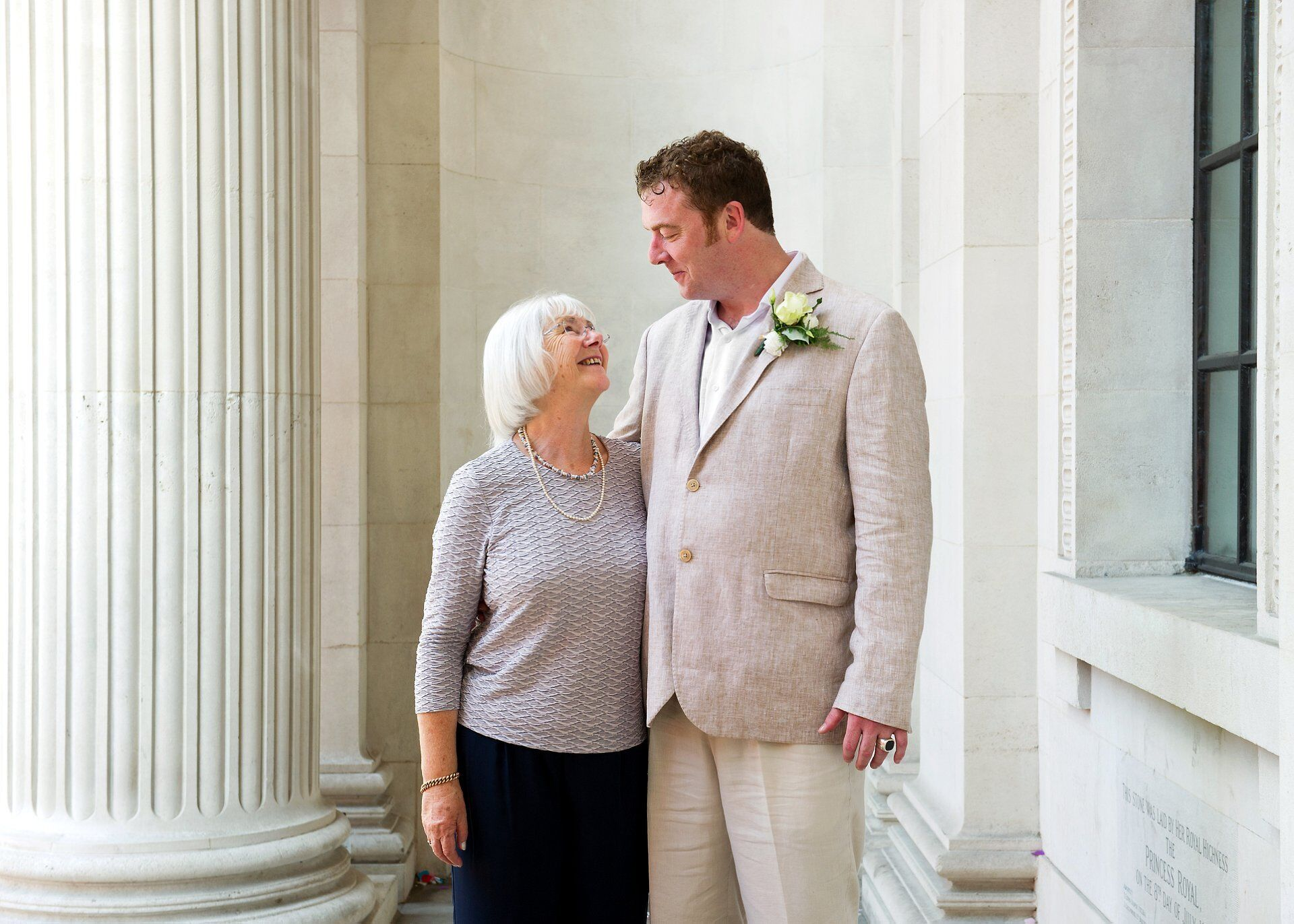 groom and his mother at old marylebone town hall just after his soho room wedding ceremony